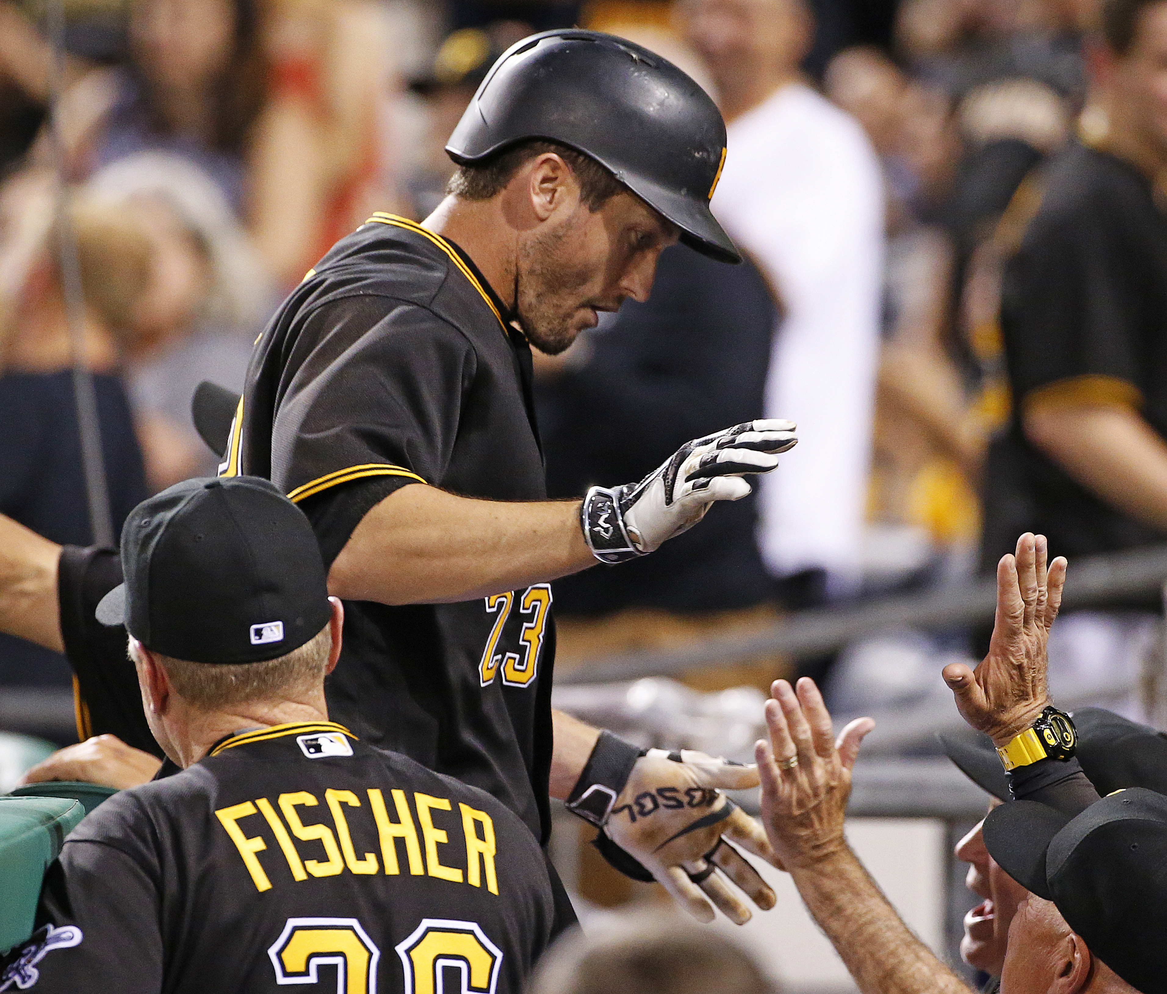 Pittsburgh Pirates' David Freese (23) returns to the dugout after hitting a two-run home run off Arizona Diamondbacks starting pitcher Rubby De La Rosa during the fifth inning of a baseball game in Pittsburgh, Wednesday, May 25, 2016. (AP Photo/Gene J. Pu