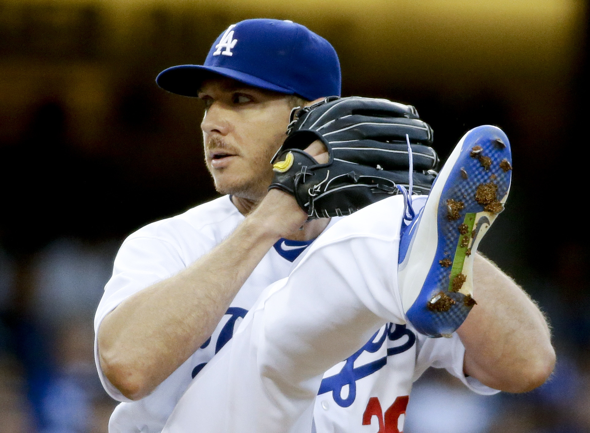 Los Angeles Dodgers starting pitcher Scott Kazmir winds up during the first inning of a baseball game against the Cincinnati Reds in Los Angeles, Wednesday, May 25, 2016. (AP Photo/Chris Carlson)