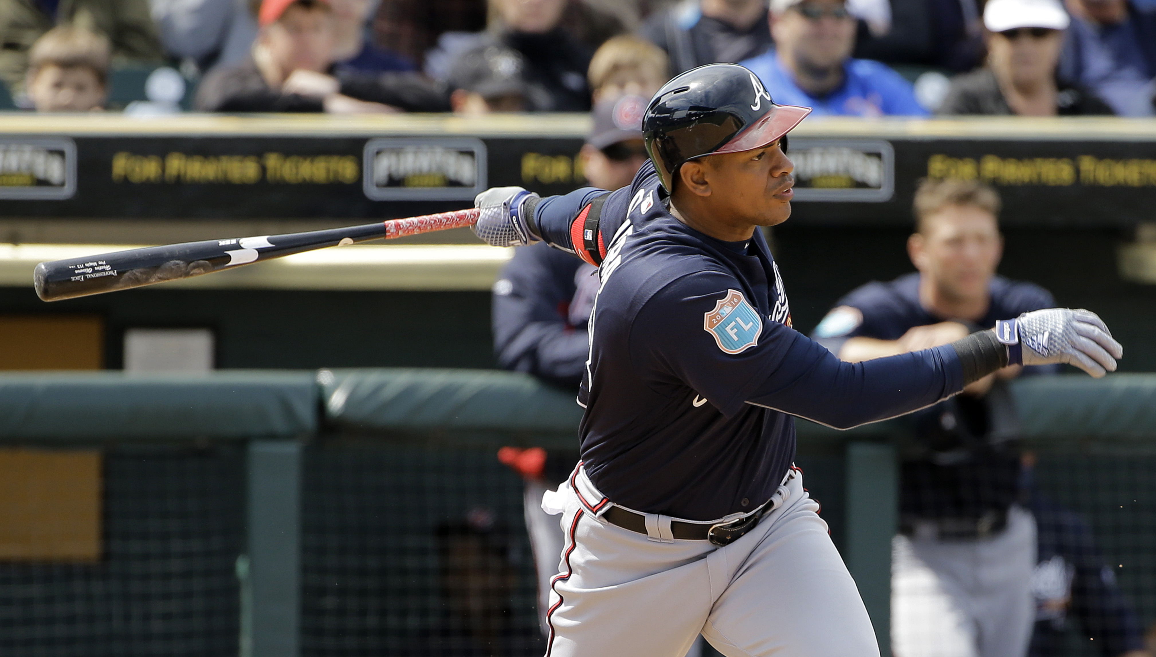 Atlanta Braves' Hector Olivera bats against the Pittsburgh Pirates during the sixth inning of a spring training baseball game Monday, March 21, 2016, in Bradenton, Fla. (AP Photo/Chris O'Meara)