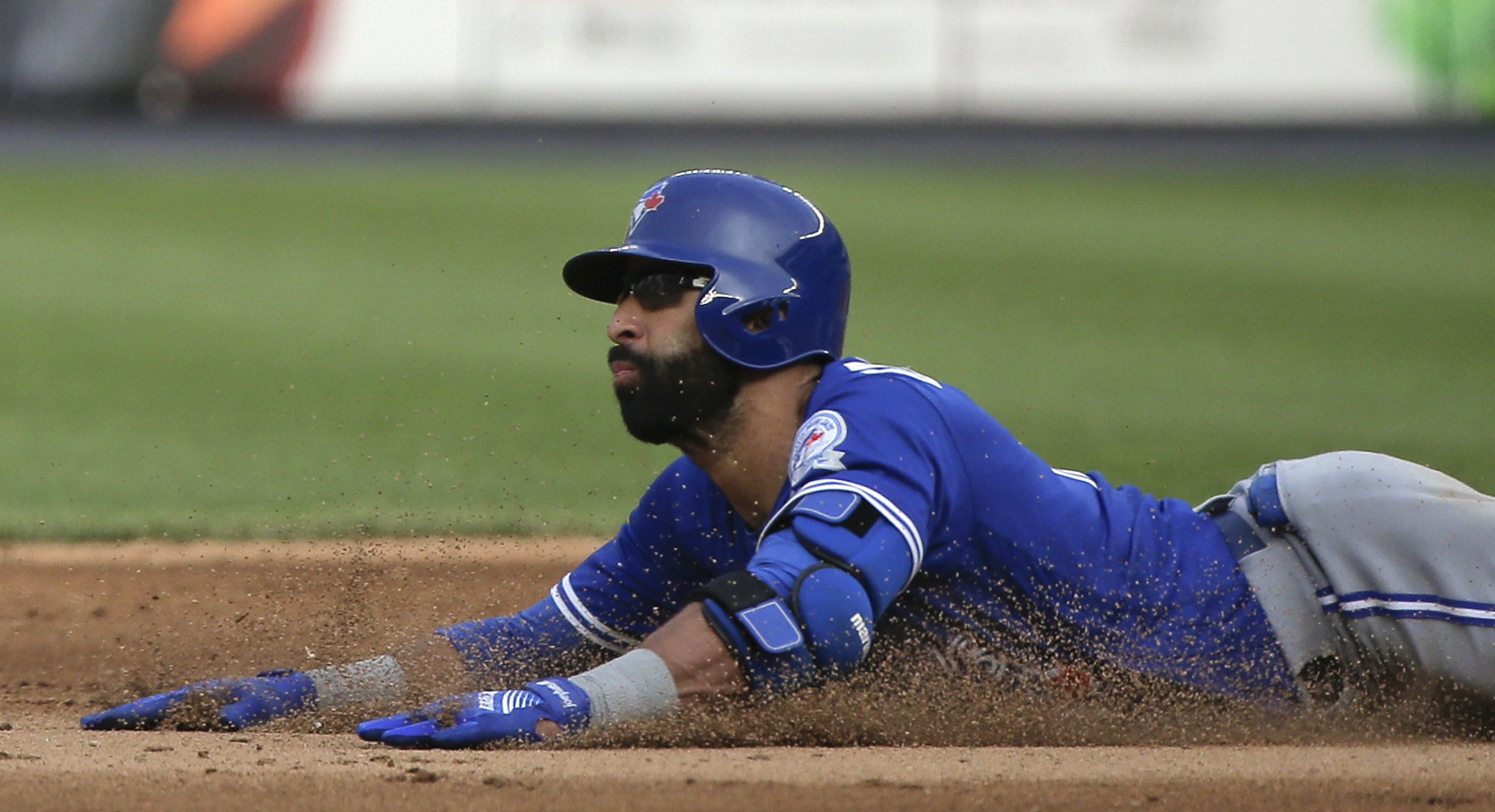 Toronto Blue Jays' Jose Bautista stretches a single into a double as he slides safely into second base during the eighth inning against the New York Yankees in a baseball game Thursday, May 26, 2016, in New York. The Blue Jays won 3-1. (AP Photo/Julie Jac