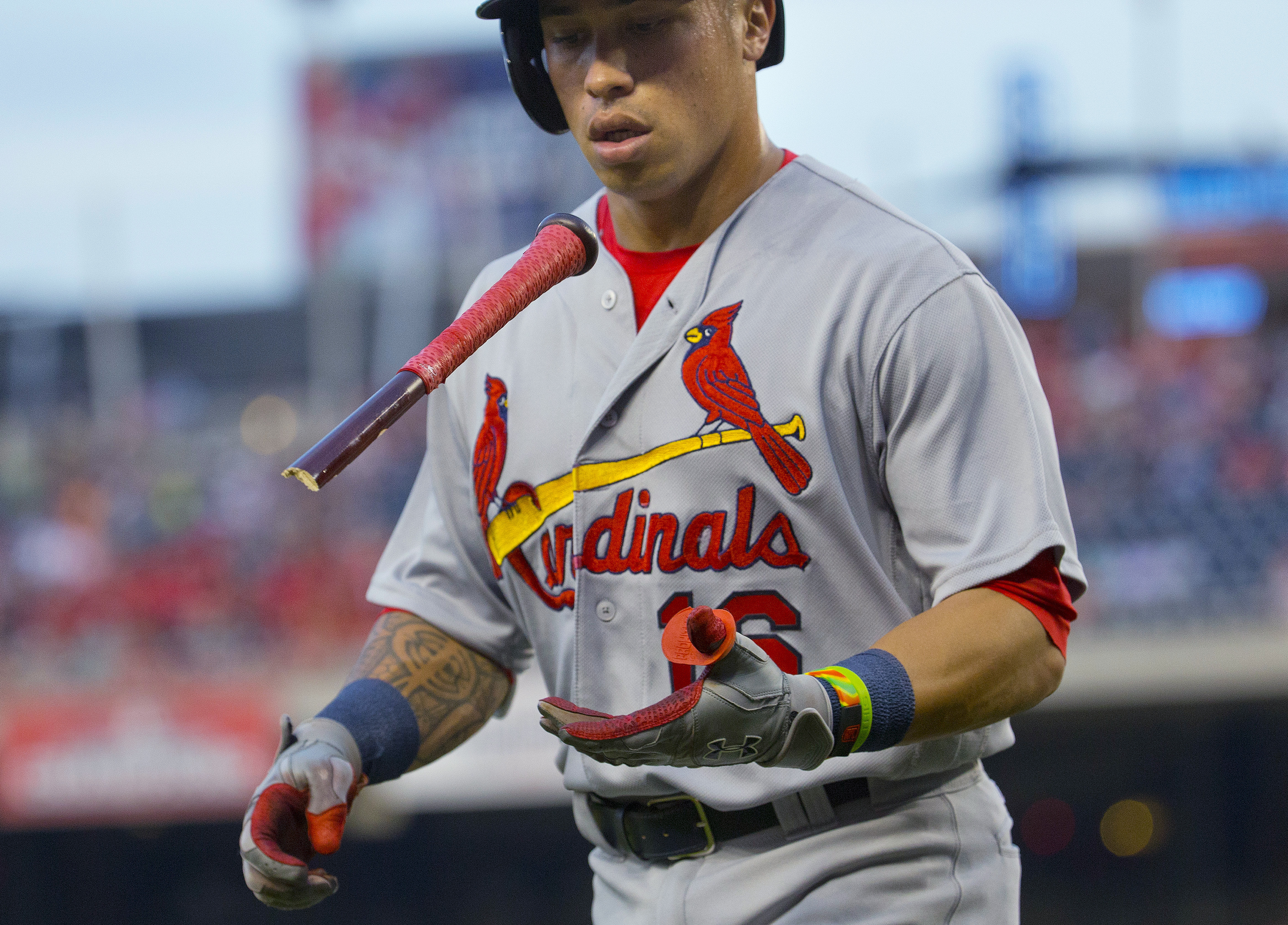 St. Louis Cardinals Kolten Wong flips what remains of his bat after breaking it while grounding out against the Washington Nationals during the third inning of a baseball game at Nationals Park, Thursday, May 26, 2016, in Washington. (AP Photo/Pablo Marti