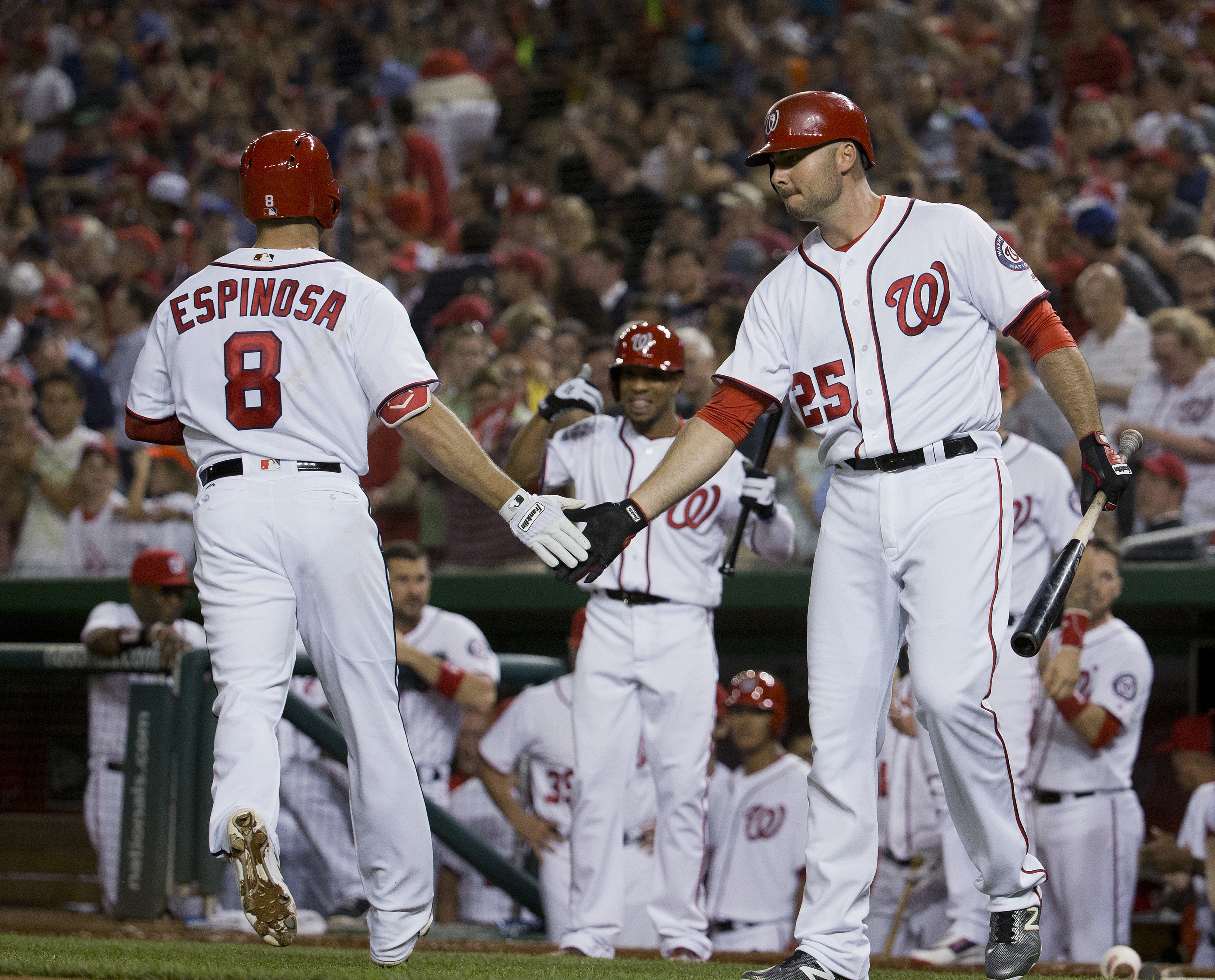 Washington Nationals' Danny Espinosa (8) is greeted by Clint Robinson (25) after hitting a solo home run off St. Louis Cardinals starting pitcher Mike Leake during the seventh inning of a baseball game at Nationals Park, Thursday, May 26, 2016, in Washing