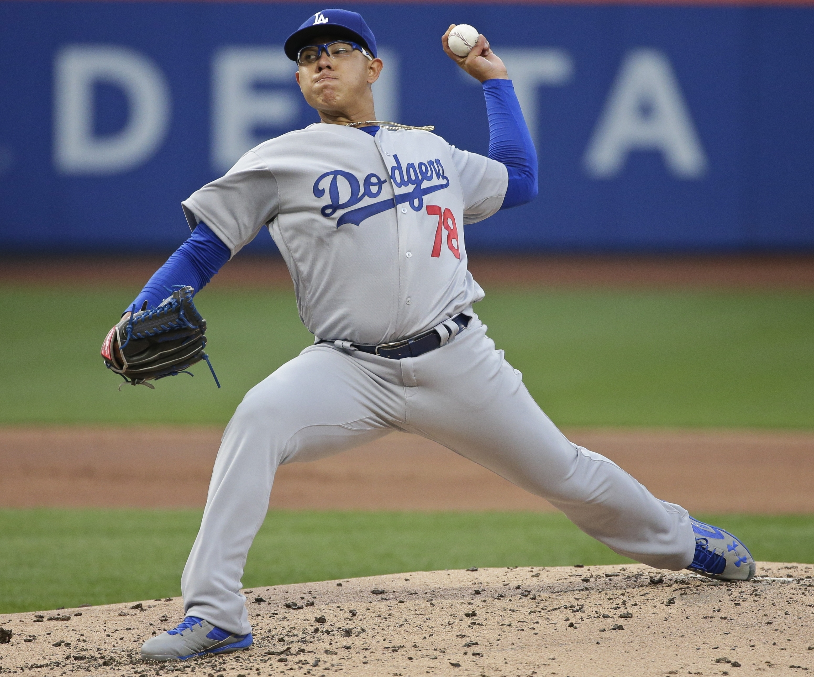 Los Angeles Dodgers' Julio Arias delivers a pitch during the first inning of a baseball game against the New York Mets on Friday, May 27, 2016, in New York. (AP Photo/Frank Franklin II)