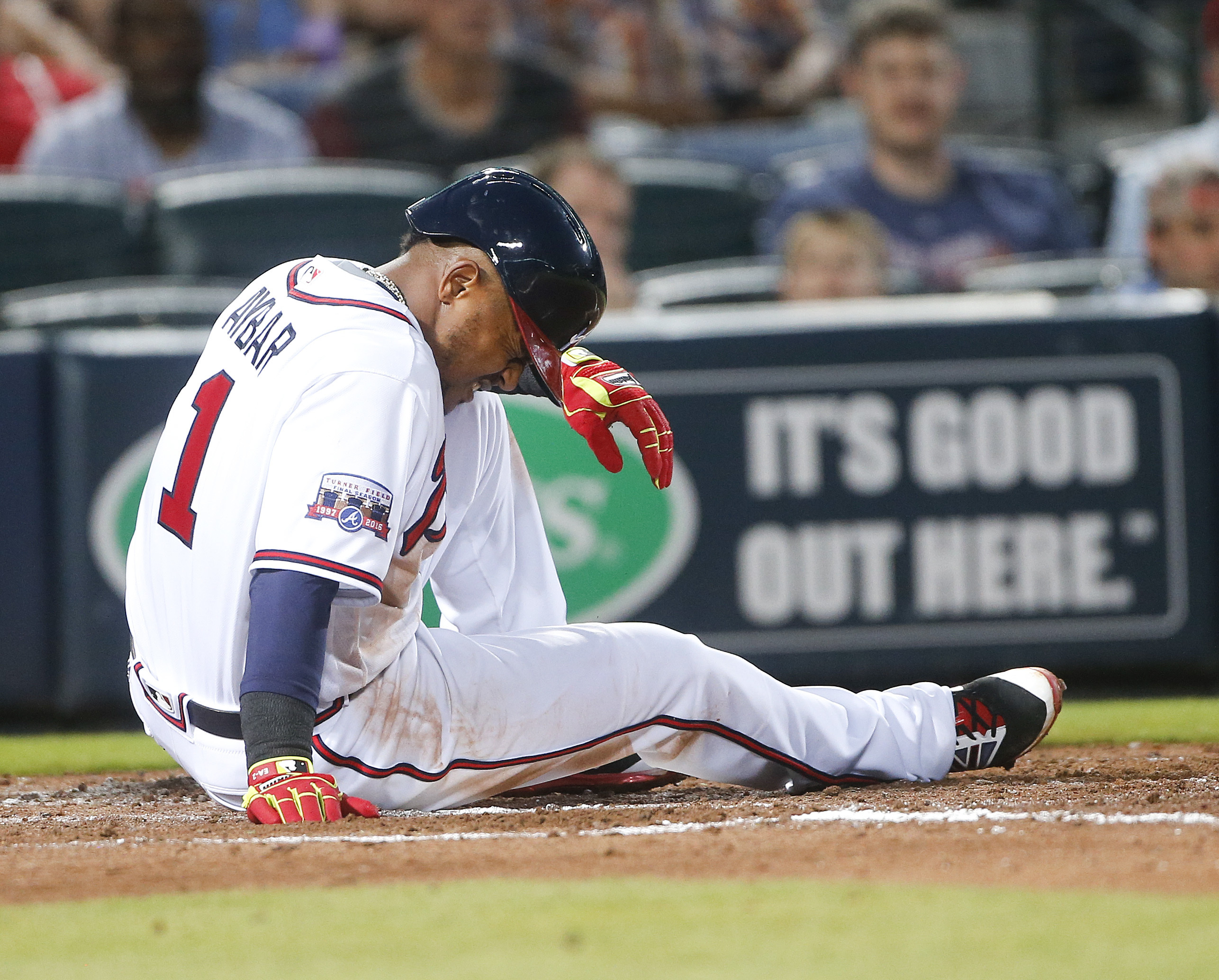 Atlanta Braves shortstop Erick Aybar (1) waits for help from the training staff after being hit by a pitch from Miami Marlins starter Adam Conley in the fourth inning of a baseball game Friday, May 27, 2016, in Atlanta. (AP Photo/John Bazemore)