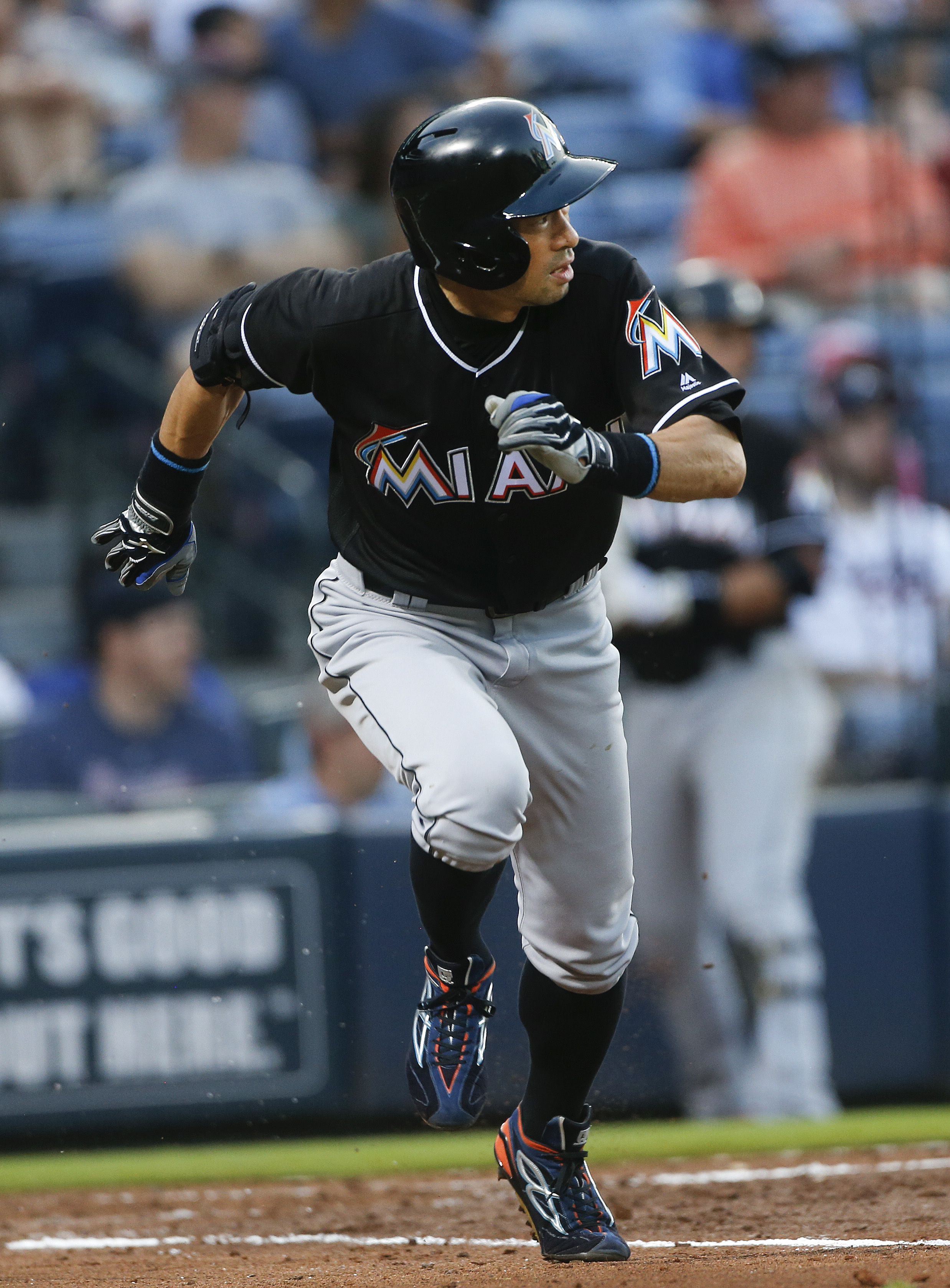 Miami Marlins' Ichiro Suzuki (51) runs to first after hitting a double in the third inning of a baseball game against the Atlanta Braves, Friday, May 27, 2016, in Atlanta. Suzuki scored later in the inning. (AP Photo/John Bazemore)