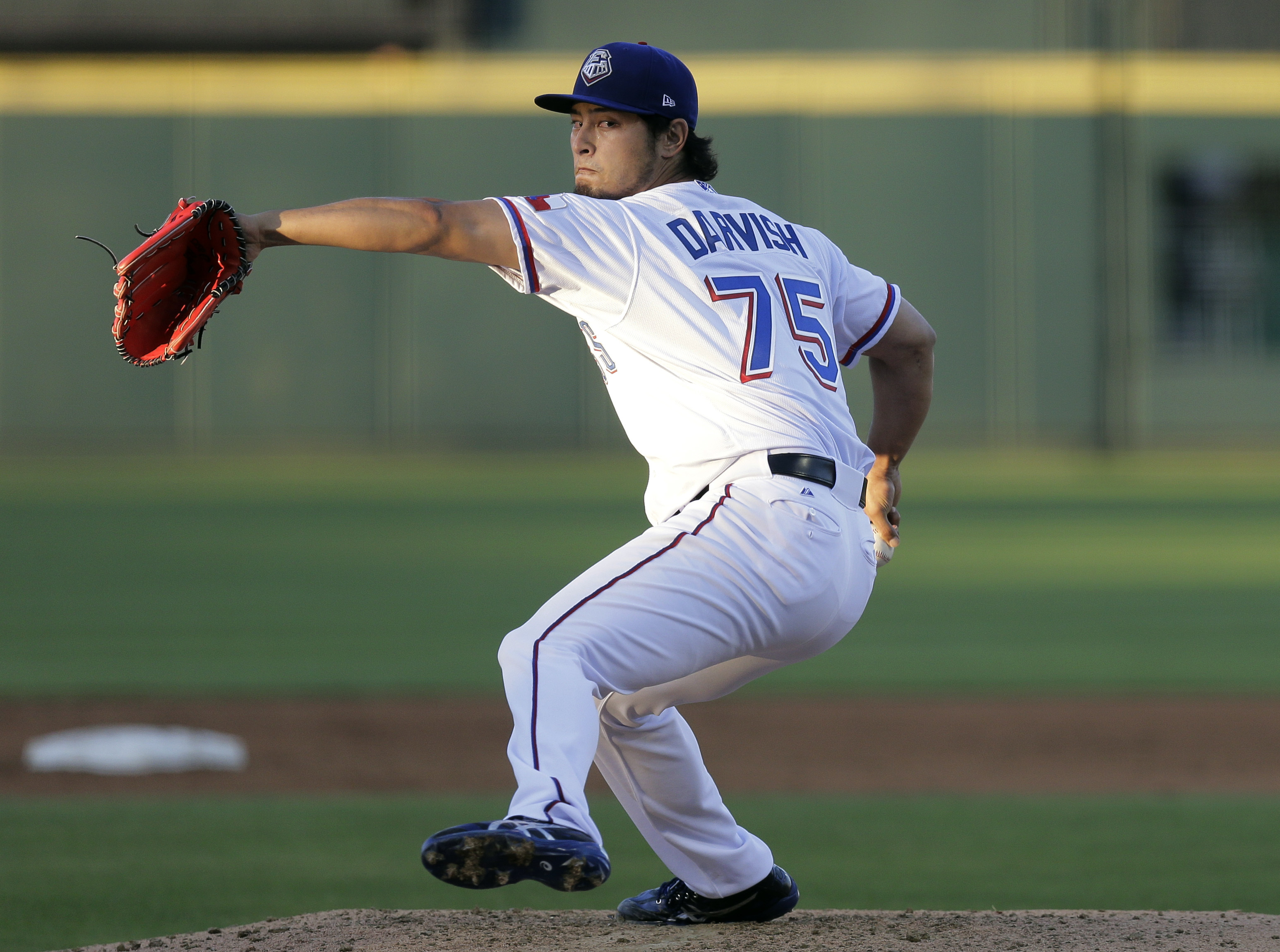 FILE- In this May 6, 2016, file photo, Texas Rangers pitcher Yu Darvish delivers during a rehab start for Triple-A Round Rock Express against the New Orleans Zephyrs during a baseball game, Friday, May 6, 2016, in Austin, Texas. Darvish missed the end of