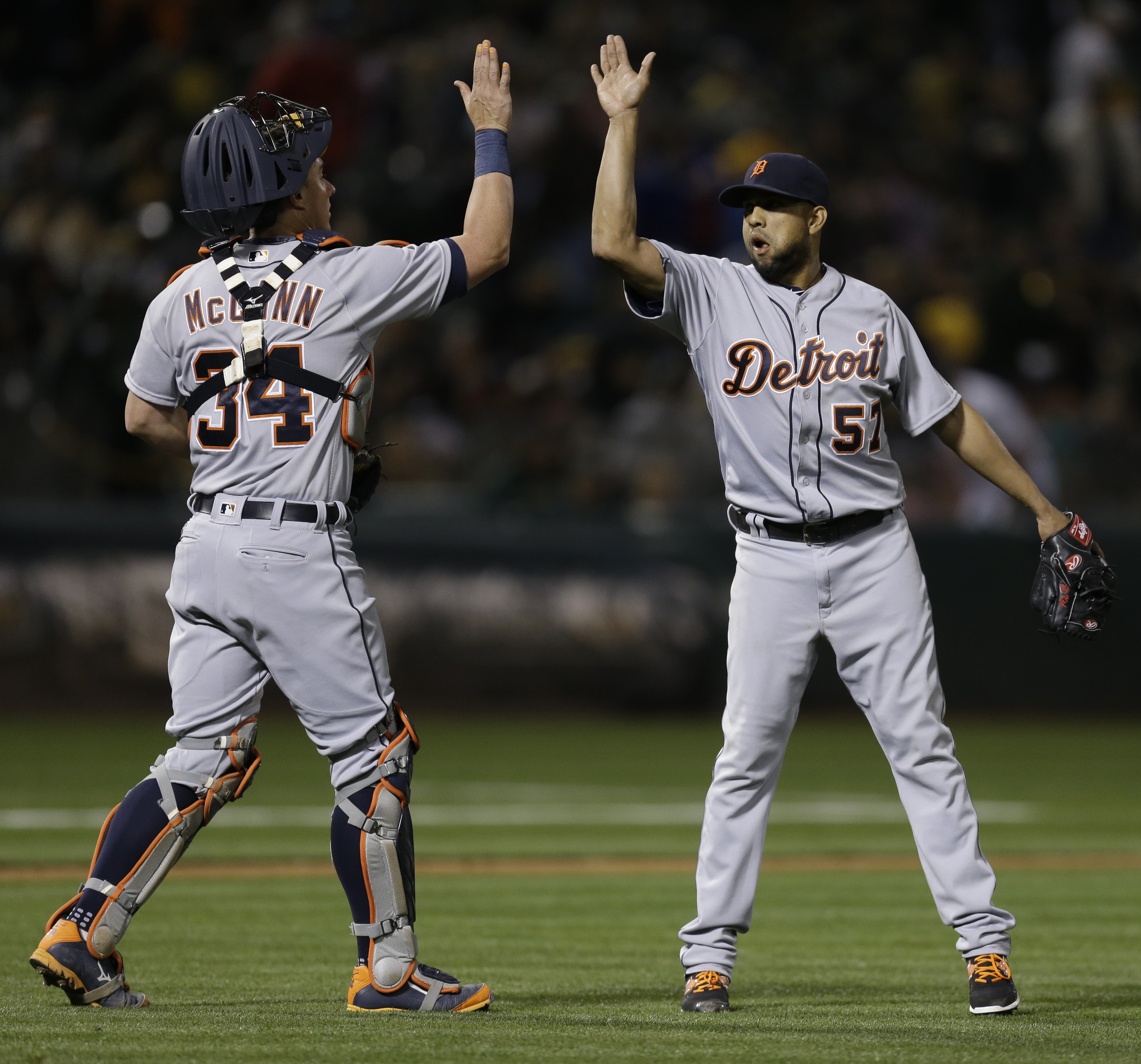 Detroit Tigers pitcher Francisco Rodriguez, right, celebrates with James McCann after the team's 4-1 win over the Oakland Athletics in a baseball game Friday, May 27, 2016, in Oakland, Calif. (AP Photo/Ben Margot)