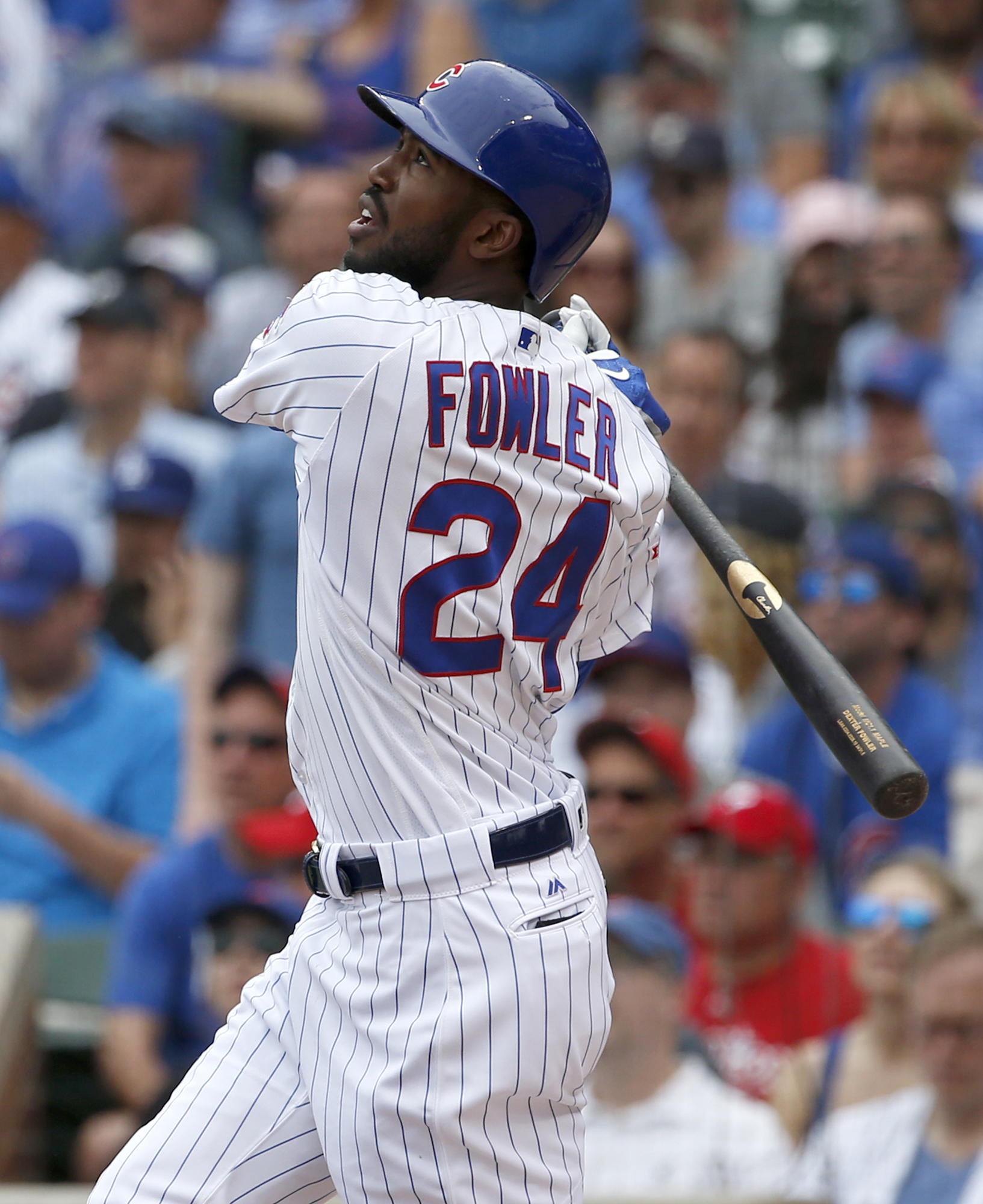 Chicago Cubs' Dexter Fowler watches his a solo home run during the first inning of a baseball game against the Philadelphia Phillies Saturday, May 28, 2016, in Chicago. (AP Photo/Nam Y. Huh)