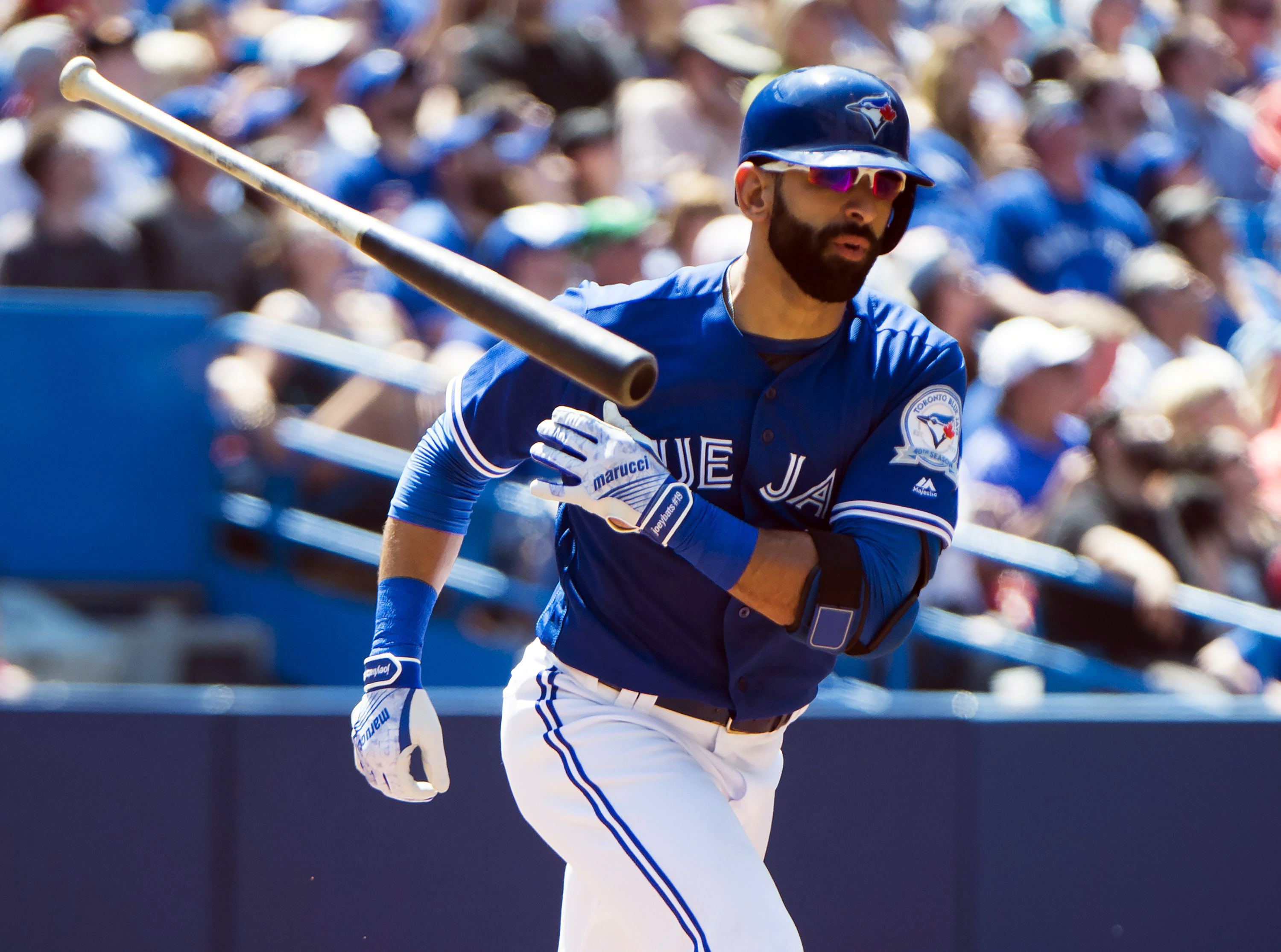 Toronto Blue Jays Bautista tosses his bat aside as he grounds out against the Boston Red Sox during the fifth inning of baseball game in Toronto, Saturday, May 28, 2016. (Nathan Denette/The Canadian Press via AP) MANDATORY CREDIT