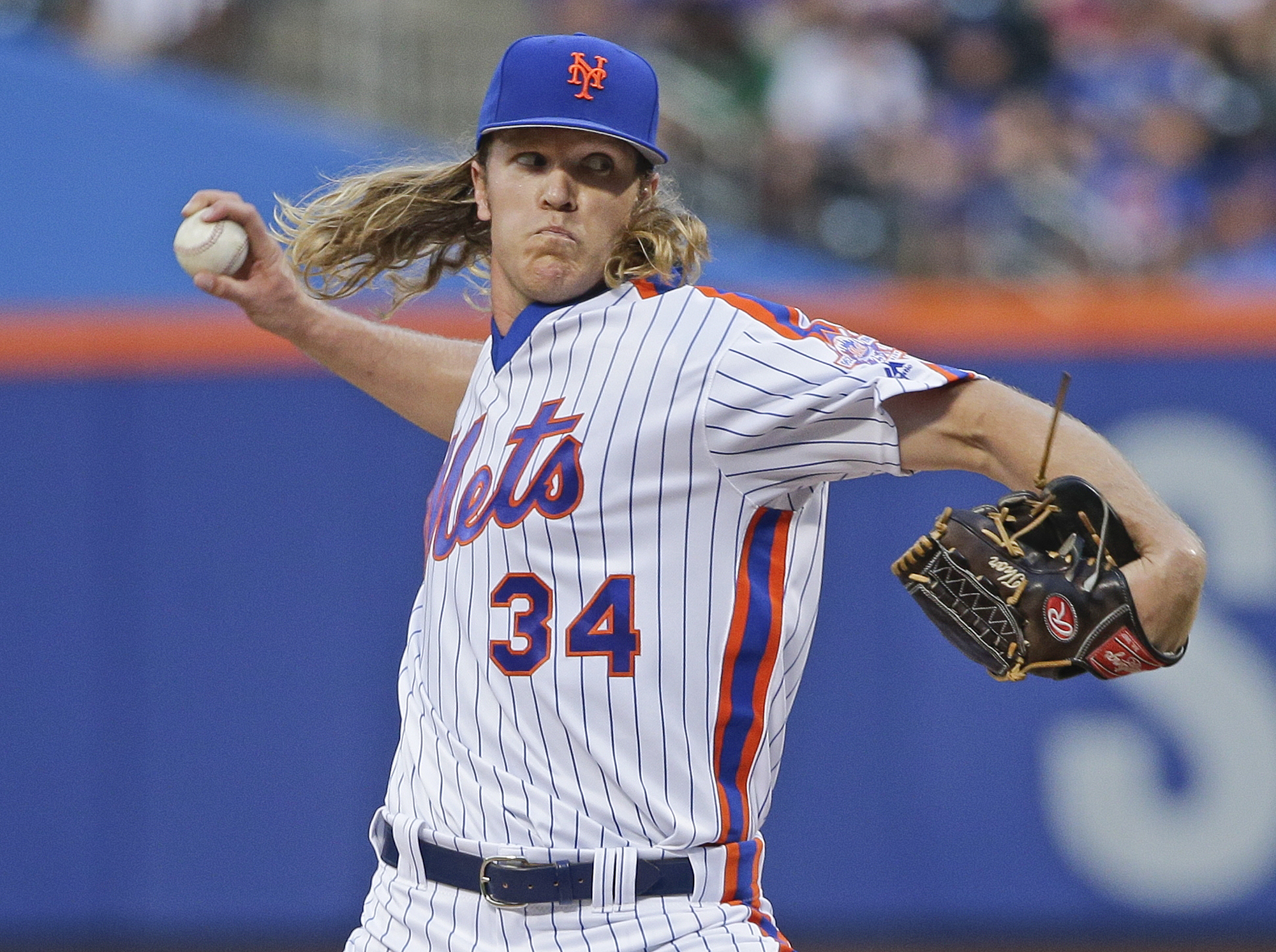 New York Mets' Noah Syndergaard delivers a pitch during the first inning of a baseball game against the Los Angeles Dodgers, Saturday, May 28, 2016, in New York. (AP Photo/Frank Franklin II)