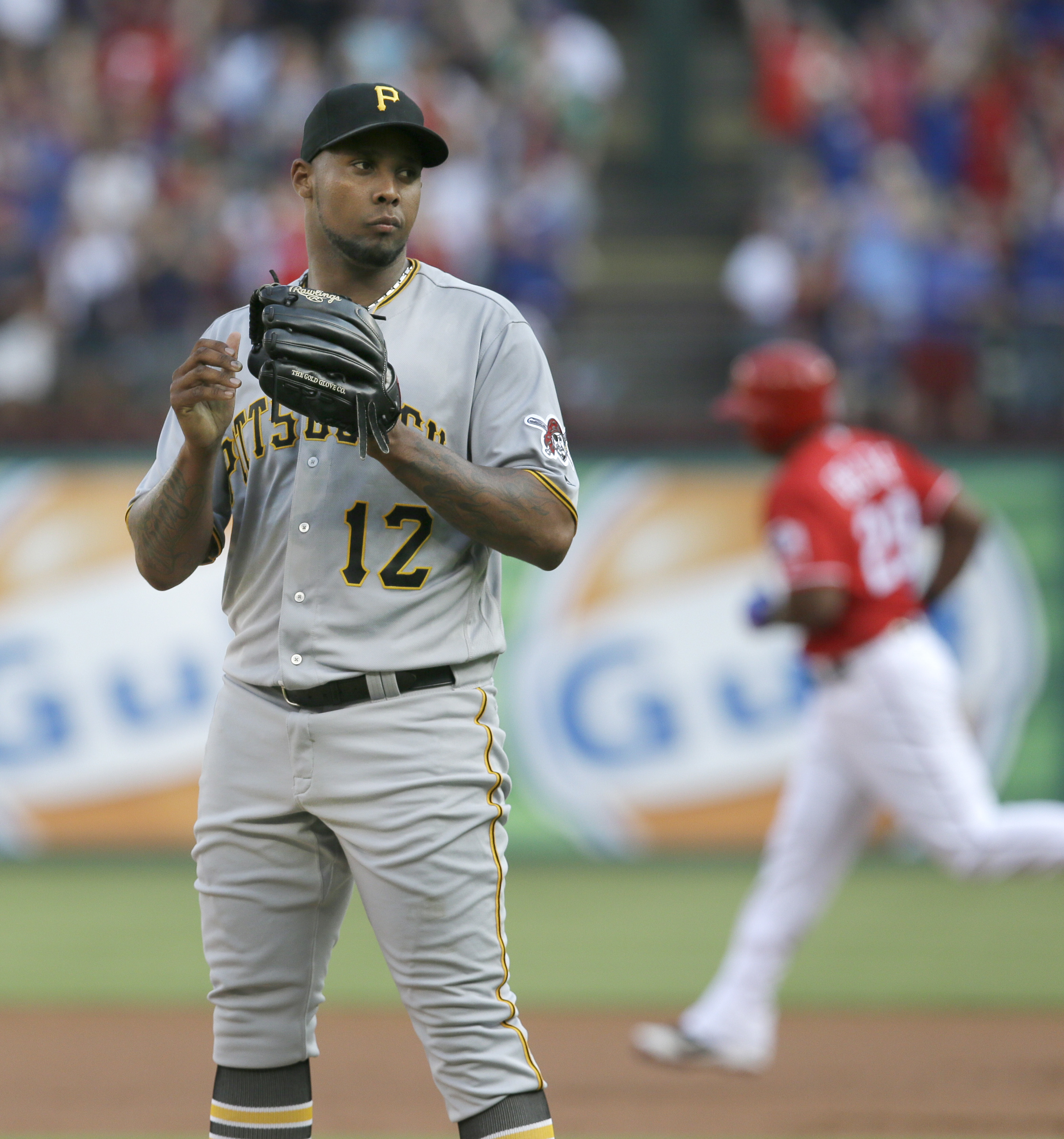 Pittsburgh Pirates starting pitcher Juan Nicasio (12) stands on the mound as Texas Rangers' Adrian Beltre runs the bases after hitting a home run during the first inning of a baseball game in Arlington, Texas, Saturday, May 28, 2016. (AP Photo/LM Otero)