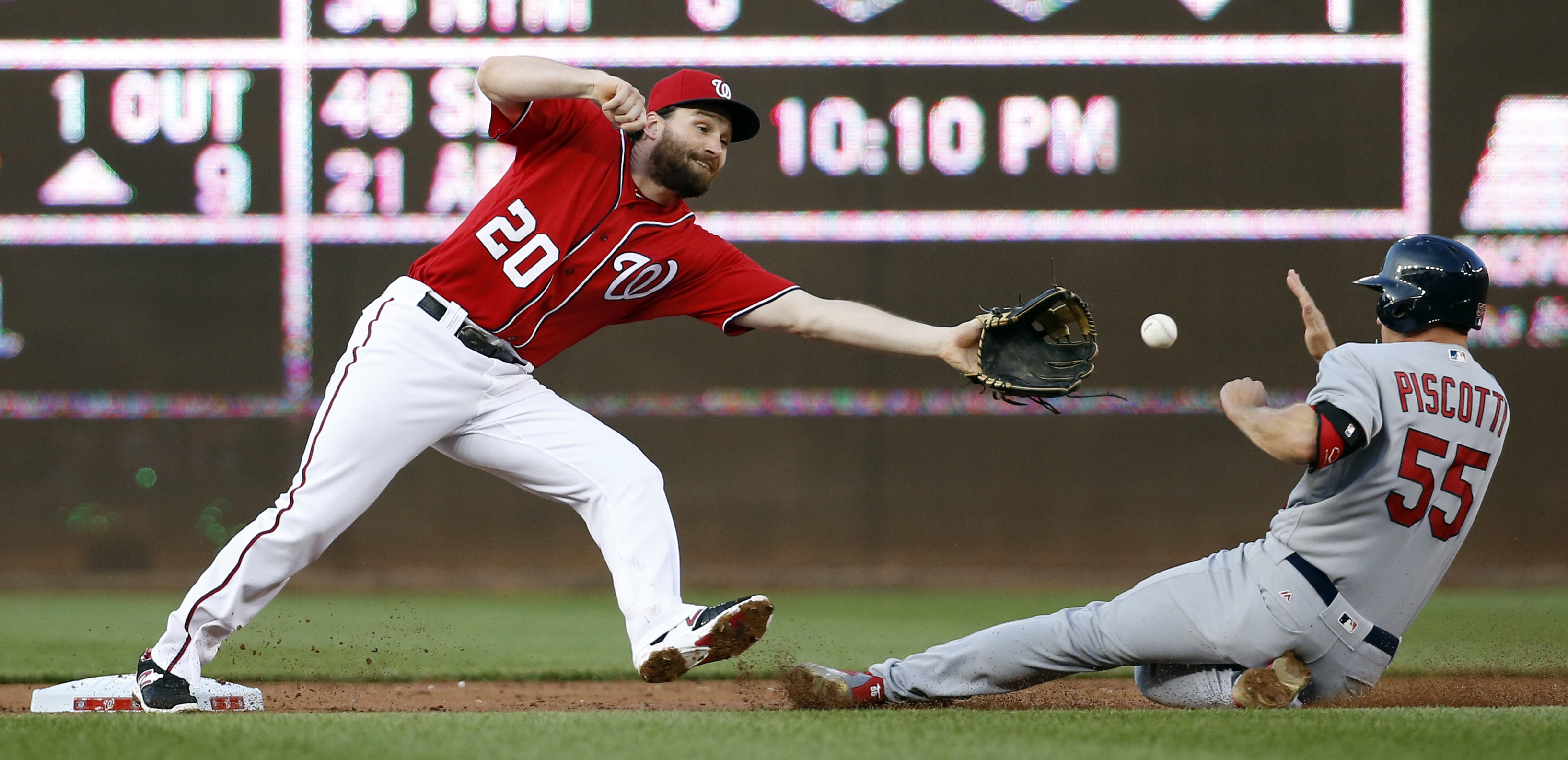 St. Louis Cardinals' Stephen Piscotty (55) safely steals second base as Washington Nationals second baseman Daniel Murphy (20) cannot get the throw in time during the second inning of a baseball game Saturday, May 28, 2016, in Washington. (AP Photo/Alex B