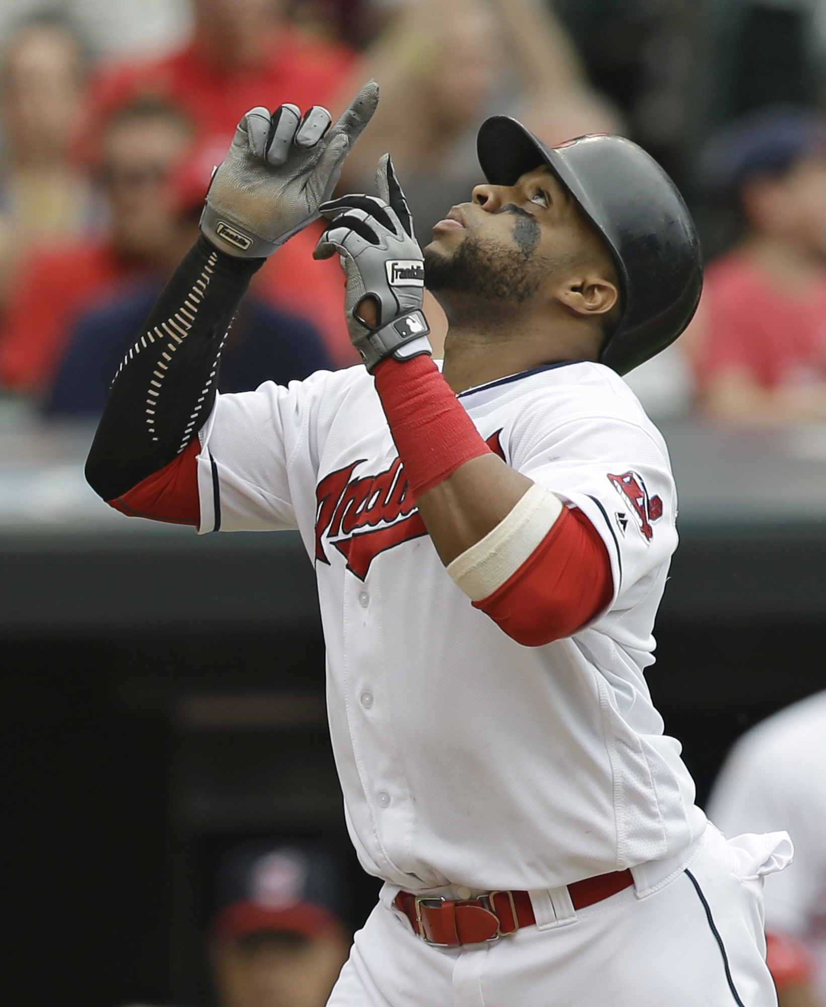 Cleveland Indians' Carlos Santana looks up after hitting a solo home run off Baltimore Orioles starting pitcher Chris Tillman in the fourth inning of a baseball game, Sunday, May 29, 2016, in Cleveland. (AP Photo/Tony Dejak)