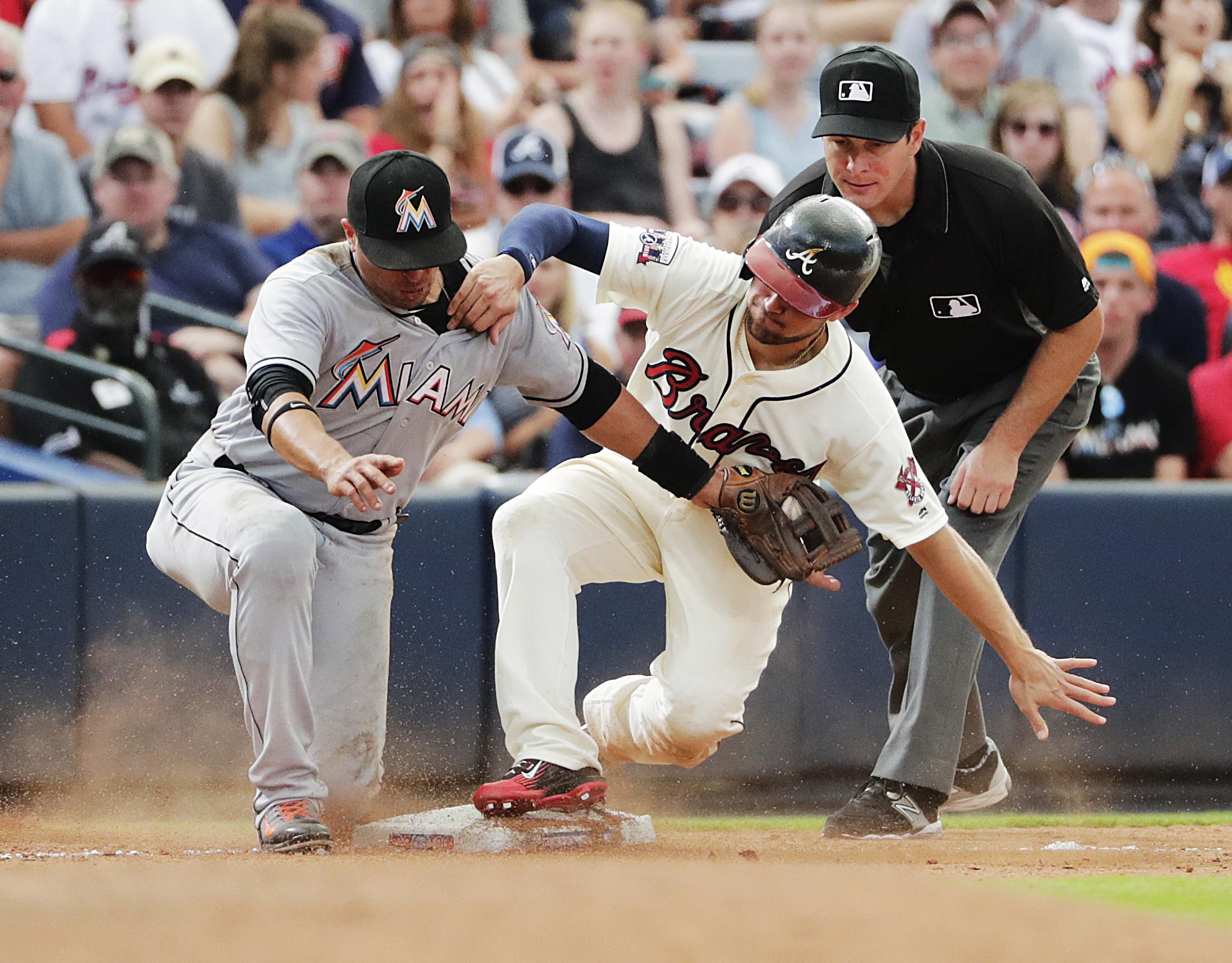 Atlanta Braves' Ender Inciarte, right, beats the tag by Miami Marlins' Martin Prado to steal third base in the eighth inning of a baseball game Sunday, May 29, 2016, in Atlanta. (AP Photo/David Goldman)