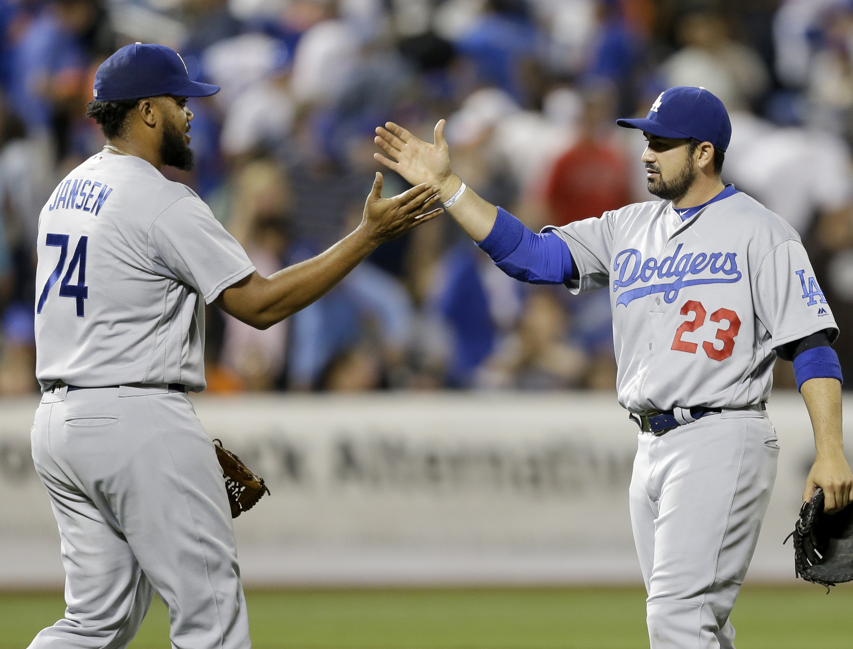 Los Angeles Dodgers relief pitcher Kenley Jansen, left, and first baseman Adrian Gonzalez celebrate after the baseball game against the New York Mets at Citi Field, Sunday, May 29, 2016 in New York. The Dodgers defeated the Mets 4-2. (AP Photo/Seth Wenig)