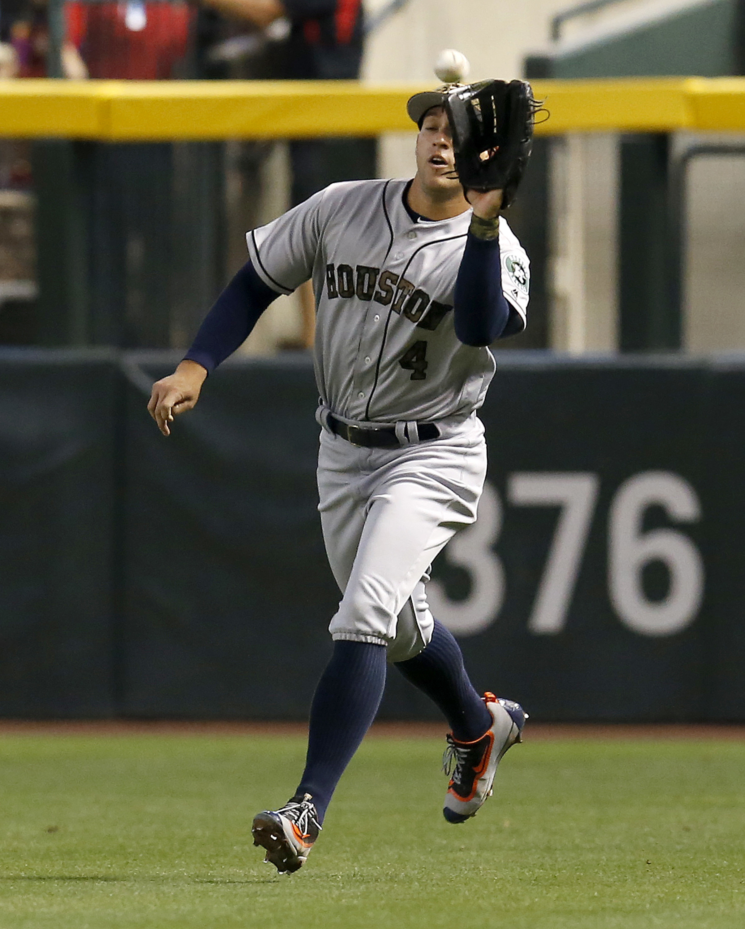 Houston Astros right fielder George Springer makes the running catch for an out against the Arizona Diamondbacks in the first inning during a baseball game, Monday, May 30, 2016, in Phoenix. (AP Photo/Rick Scuteri)