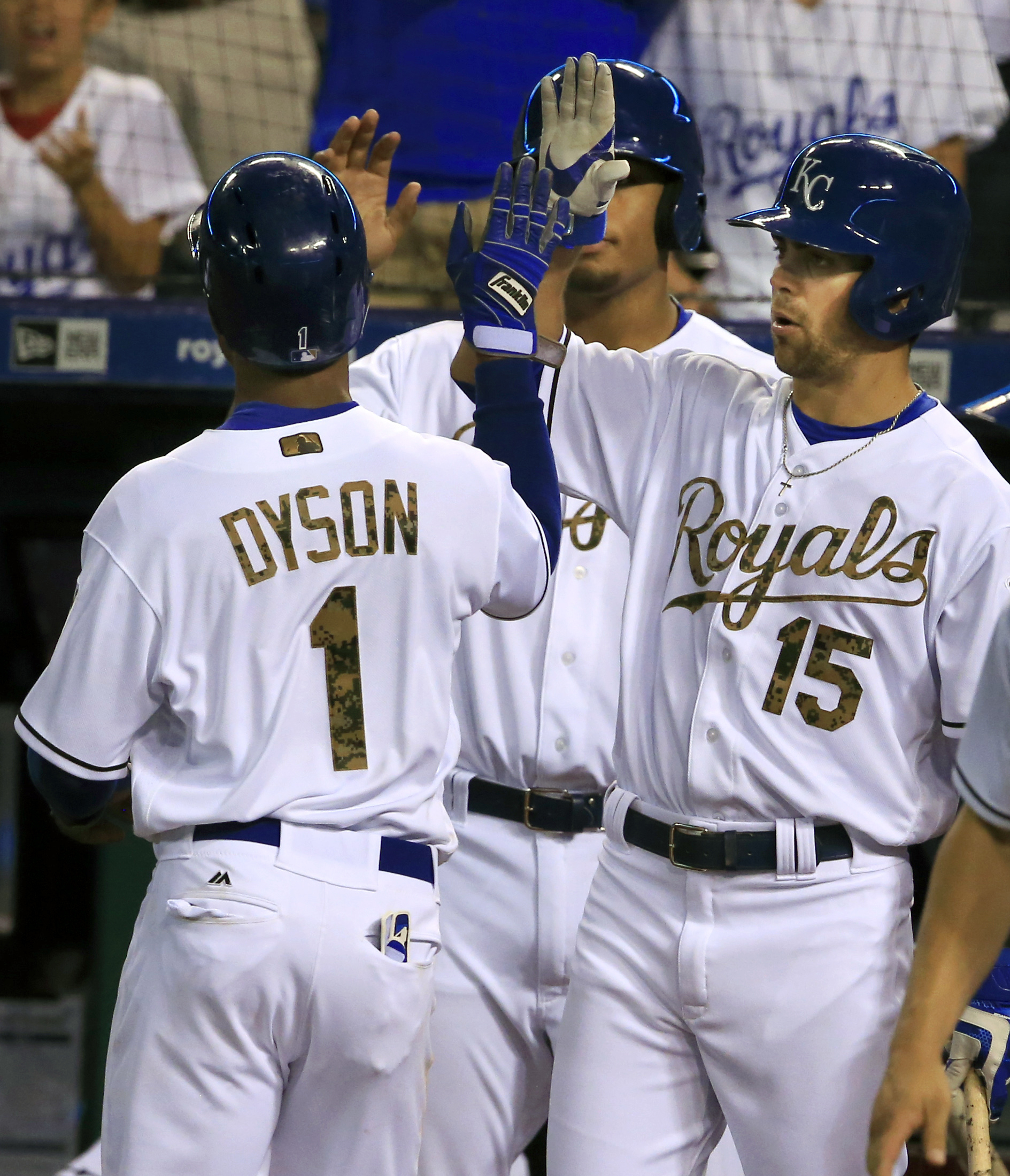 Kansas City Royals' Jarrod Dyson (1) is congratulated by teammate Whit Merrifield (15) after scoring during the fifth inning of a baseball game against the Tampa Bay Rays at Kauffman Stadium in Kansas City, Mo., Monday, May 30, 2016. (AP Photo/Orlin Wagne