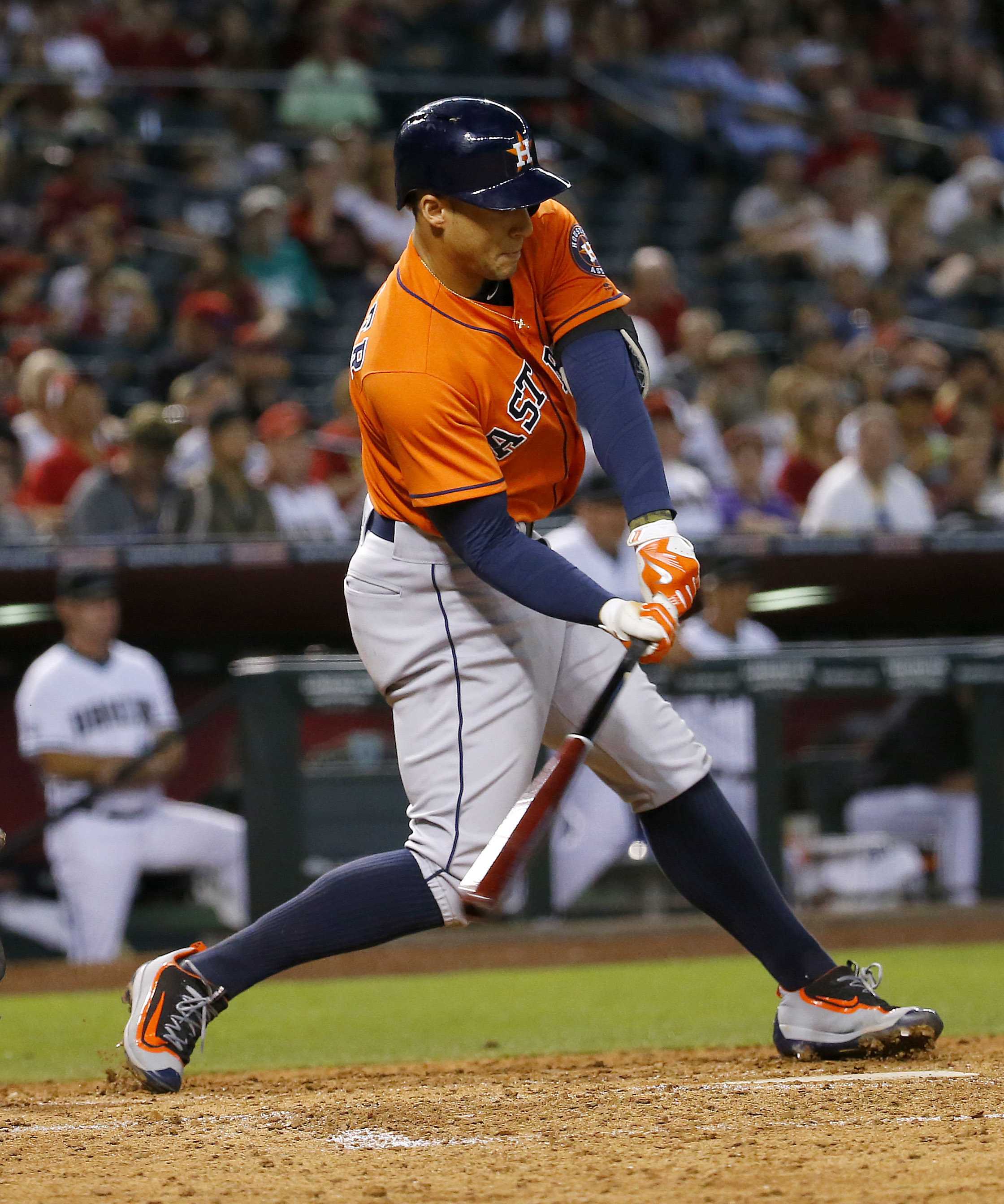 Houston Astros' George Springer connects for an RBI base hit against the Arizona Diamondbacks during the fourth inning of a baseball game, Tuesday, May 31, 2016, in Phoenix. (AP Photo/Matt York)