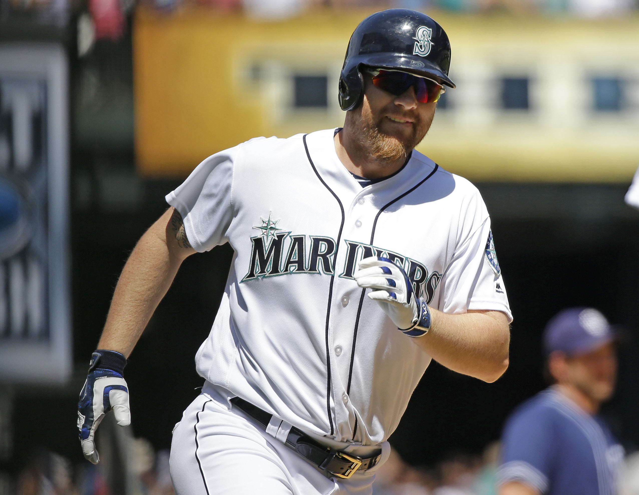 Seattle Mariners' Adam Lind rounds the bases after he hit a two-run home run in the fifth inning of a baseball game against the San Diego Padres to score Kyle Seager, Tuesday, May 31, 2016, in Seattle. (AP Photo/Ted S. Warren)