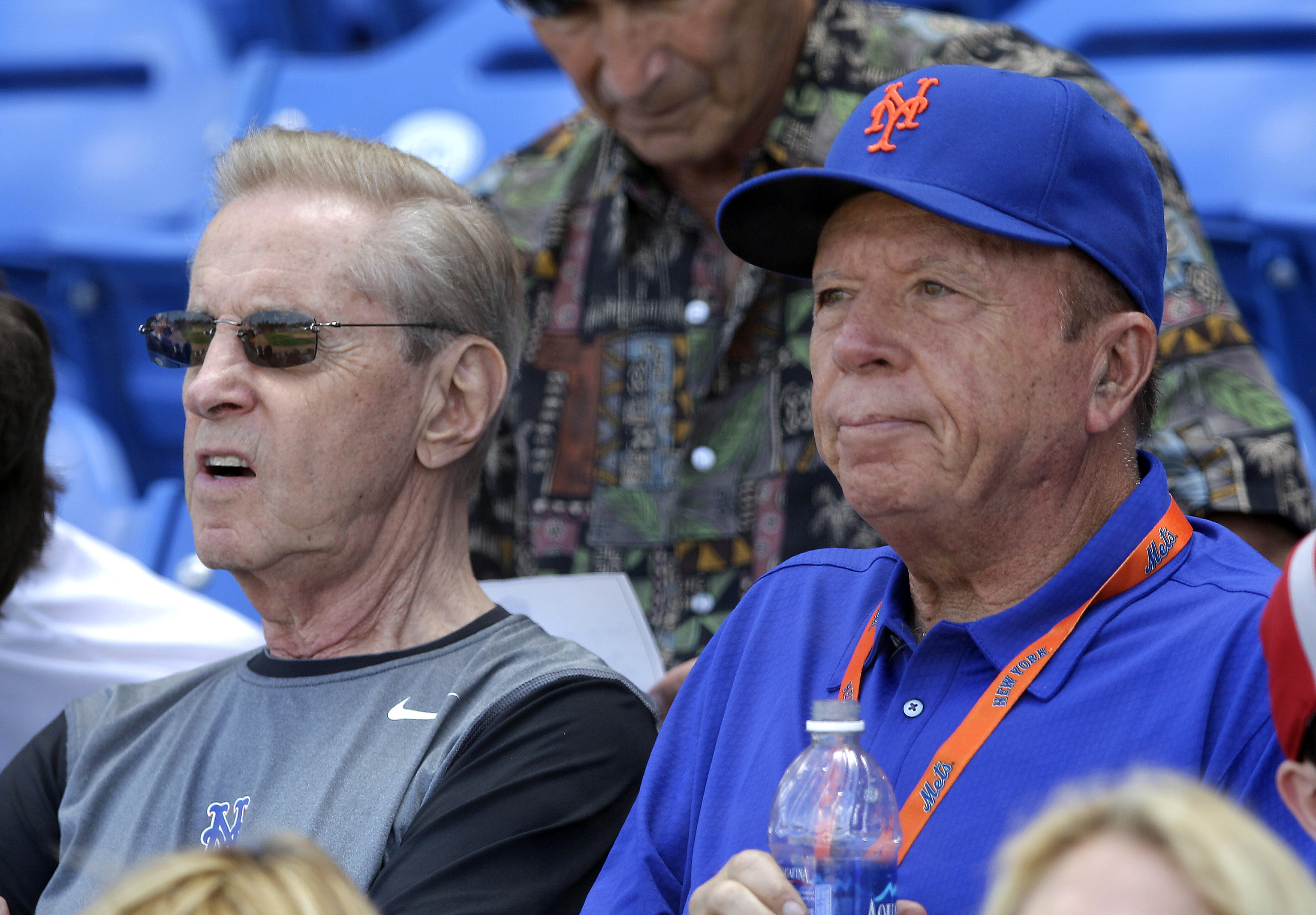 FILE- In this March 22, 2012, file photo, New York Mets owners Fred Wilpon, left, and Saul Katz watch a spring training baseball game between the Mets and the Houston Astros in Port St. Lucie, Fla. The Mets' primary owners and their affiliates owe at most
