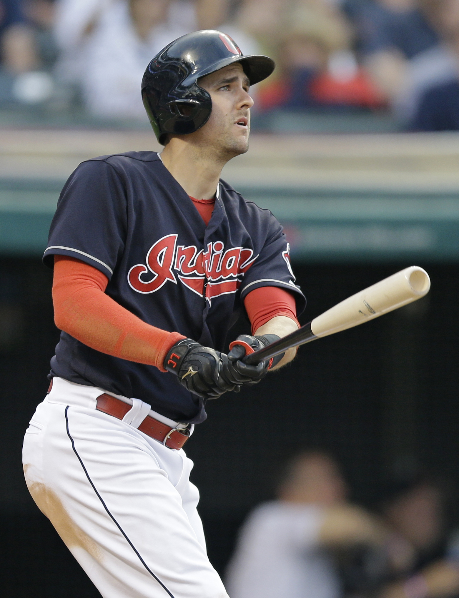 Cleveland Indians' Lonnie Chisenhall watches his two-run home run off Texas Rangers relief pitcher Tony Barnette during the seventh inning of a baseball game, Tuesday, May 31, 2016, in Cleveland. Jose Ramirez scored on the play. (AP Photo/Tony Dejak)