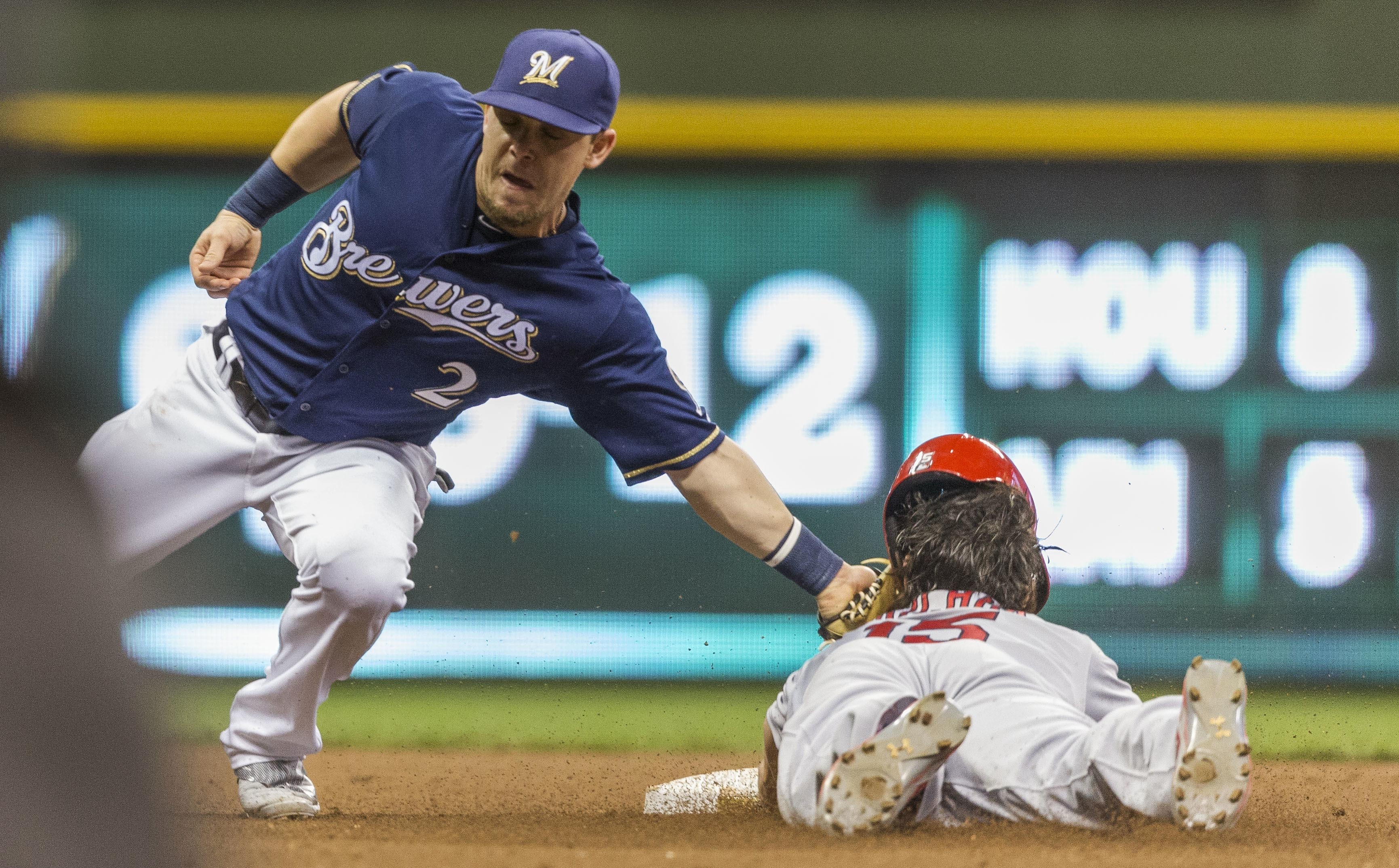 Milwaukee Brewers' Scooter Gennett tags out St. Louis Cardinals' Randal Grichuk on a steal attempt during the fourth inning of a baseball game Tuesday, May 31, 2016, in Milwaukee. (AP Photo/Tom Lynn)