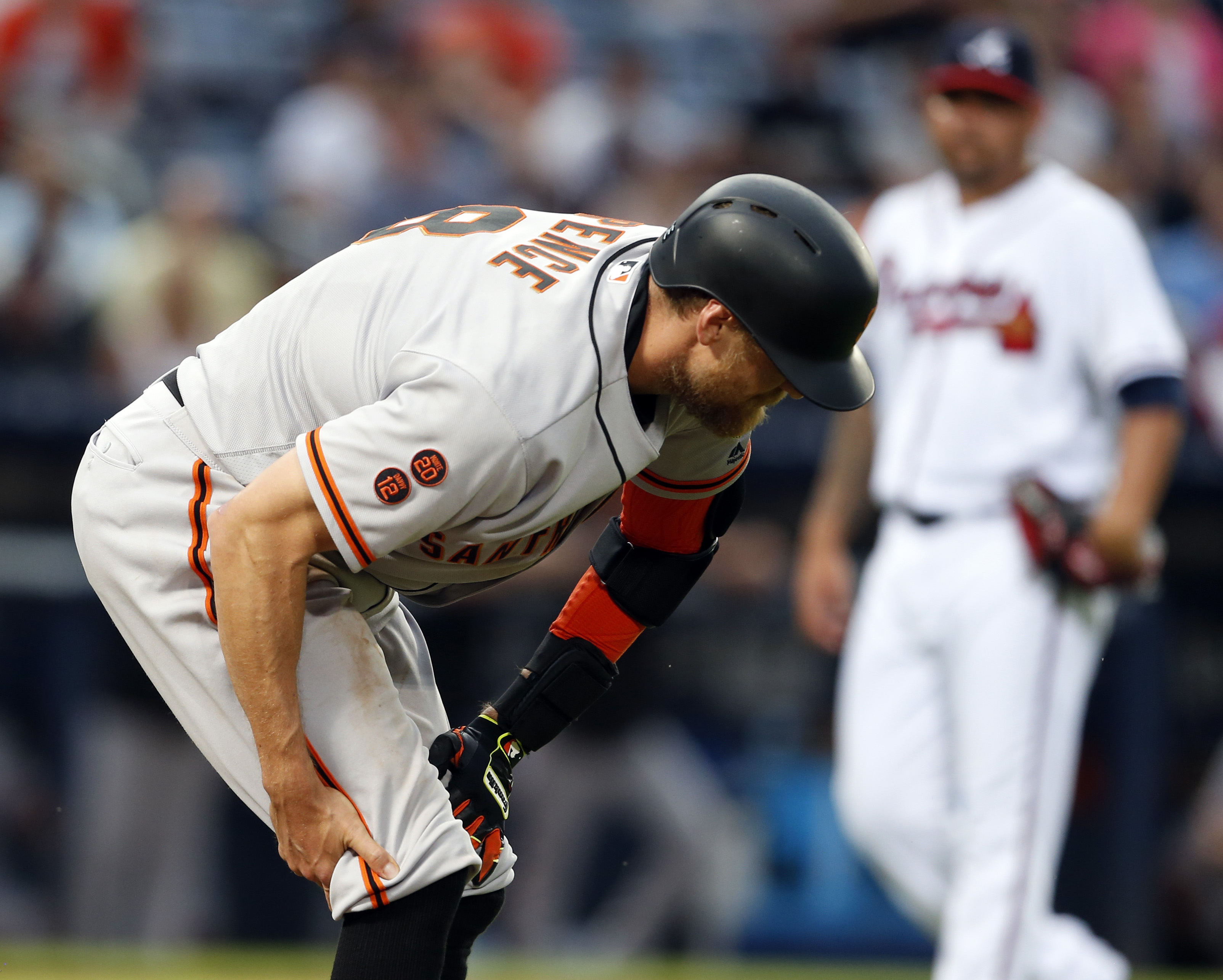 San Francisco Giants' Hunter Pence pulls up and grabs his leg as he ran to first during the fourth inning of a baseball game against the Atlanta Braves, Wednesday, June 1, 2016, in Atlanta. (AP Photo/Butch Dill)