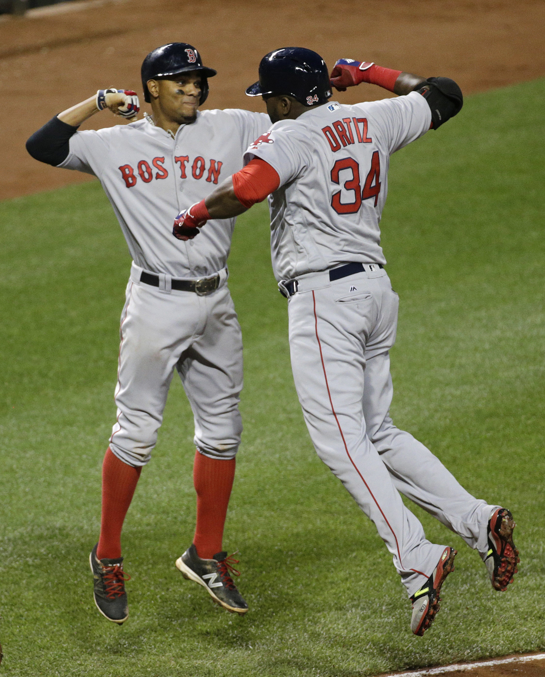Boston Red Sox's Xander Bogaerts, left, and David Ortiz celebrate after Ortiz drove Bogaerts in on a three-run home run during the sixth inning of a baseball game against the Baltimore Orioles in Baltimore, Thursday, June 2, 2016. (AP Photo/Patrick Semans