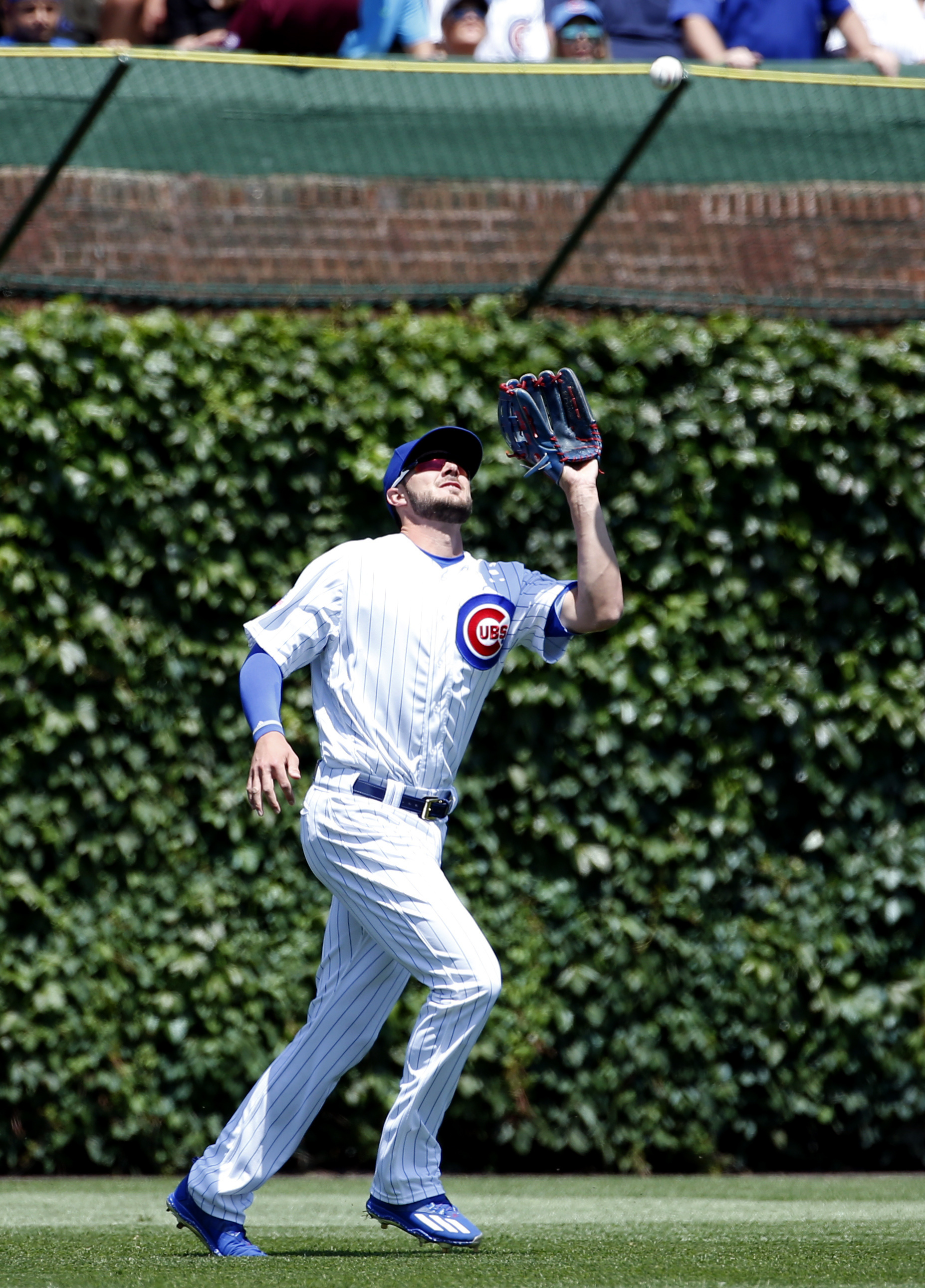 Chicago Cubs left fielder Kris Bryant catches a fly ball hit by Arizona Diamondbacks' Paul Goldschmidt during the first inning of a baseball game Friday, June 3, 2016, in Chicago. (AP Photo/Nam Y. Huh)