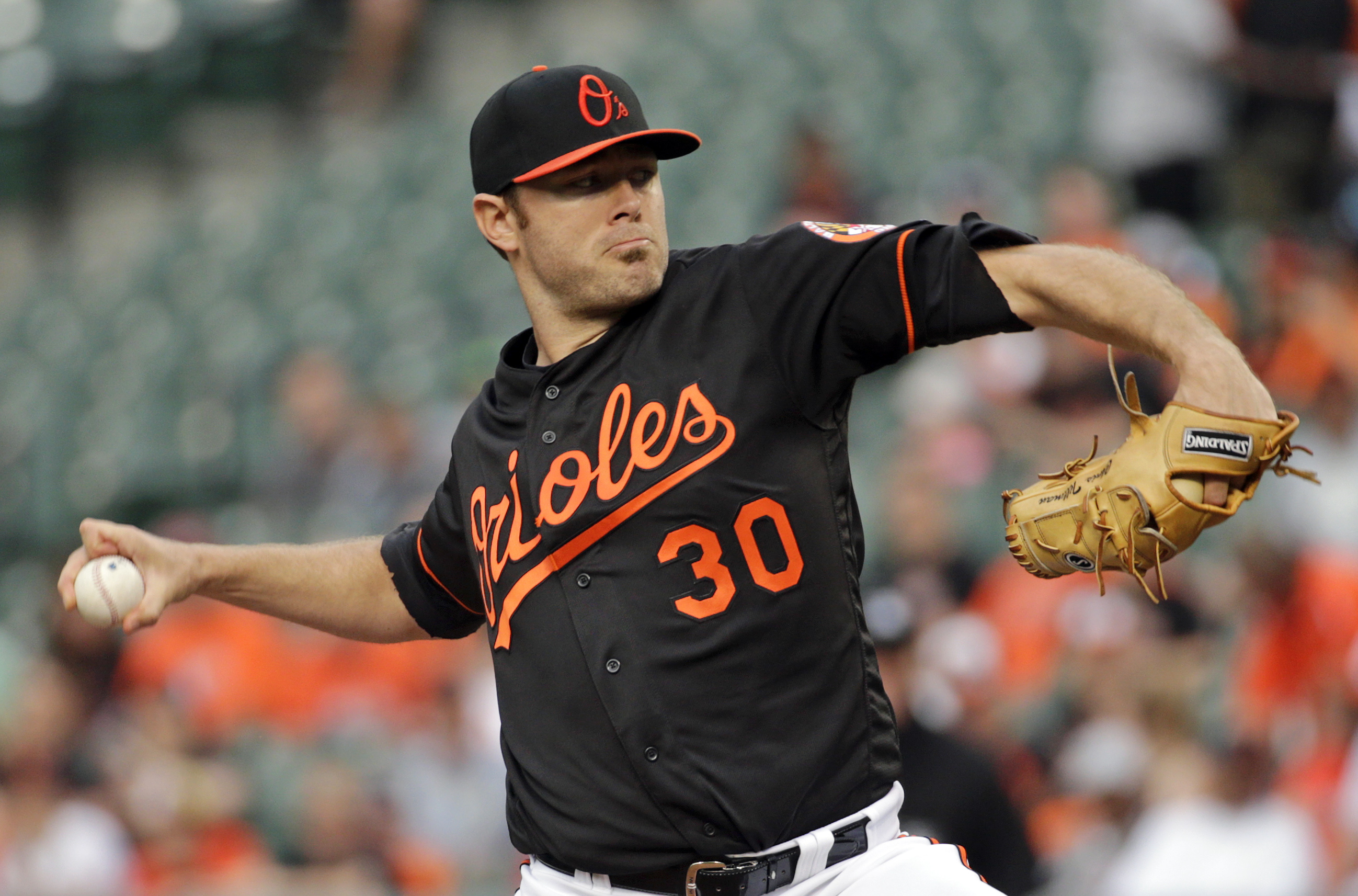 Baltimore Orioles starting pitcher Chris Tillman throws to the New York Yankees in the first inning of a baseball game in Baltimore, Friday, June 3, 2016. (AP Photo/Patrick Semansky)