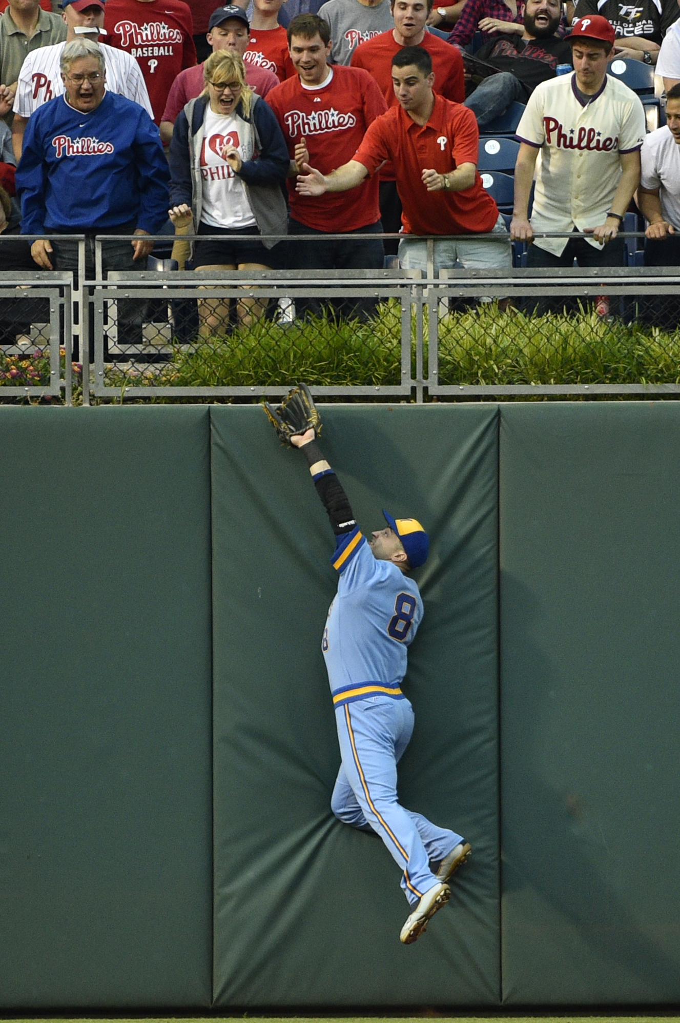 Milwaukee Brewers left fielder Ryan Braun makes a leaping catch against the wall on a fly ball hit by Philadelphia Phillies' Cody Asche during the second inning of a baseball game, Friday, June 3, 2016, in Philadelphia. (AP Photo/Derik Hamilton)