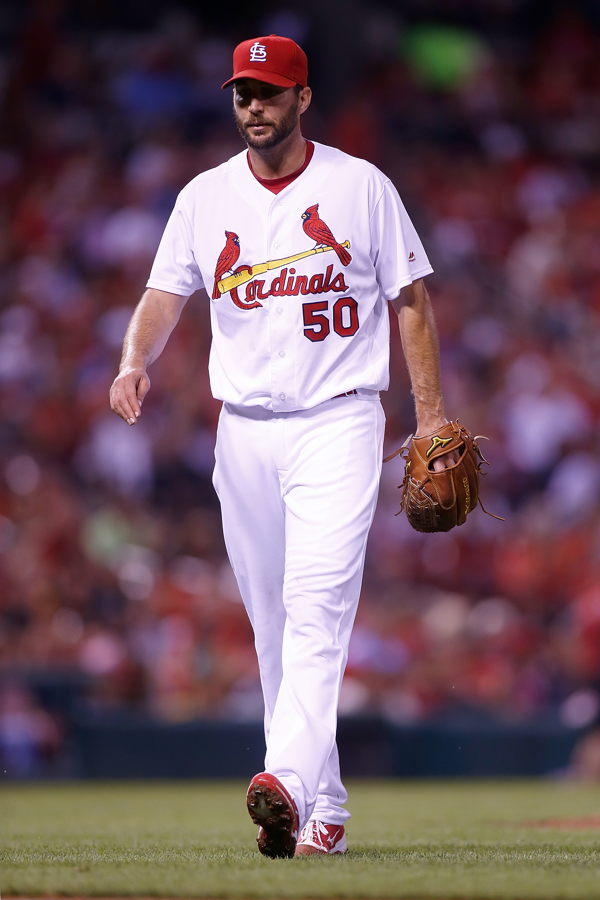 St. Louis Cardinals starting pitcher Adam Wainwright walks to the dugout after pitching during the fourth inning of a baseball game against the San Francisco Giants Friday, June 3, 2016 in St. Louis. (AP Photo/Scott Kane)