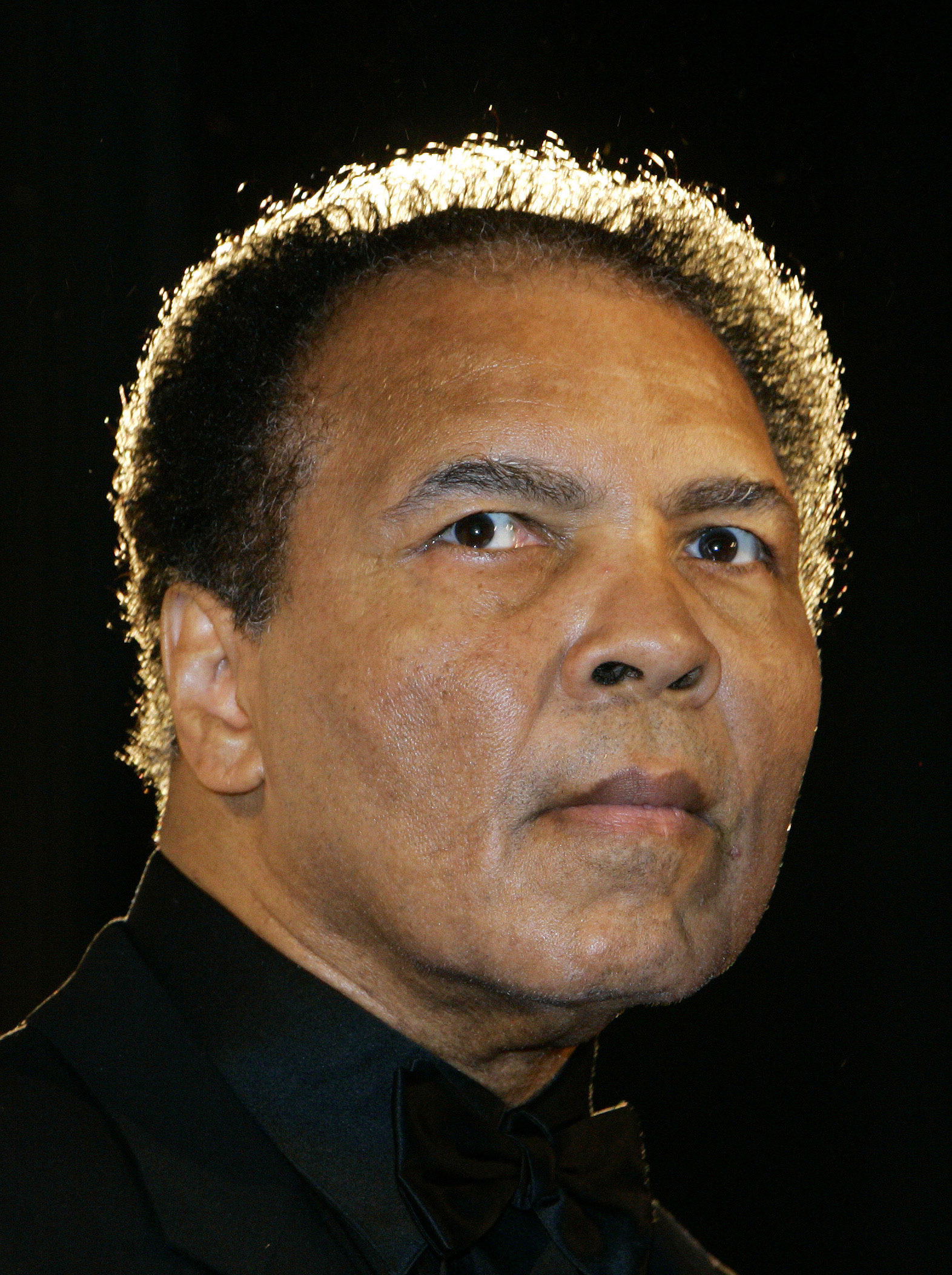 FILE - In this Dec. 17, 2005, file photo, boxing legend Muhammad Ali poses in Berlin, Germany.  Ali, the magnificent heavyweight champion whose fast fists and irrepressible personality transcended sports and captivated the world, has died according to a s
