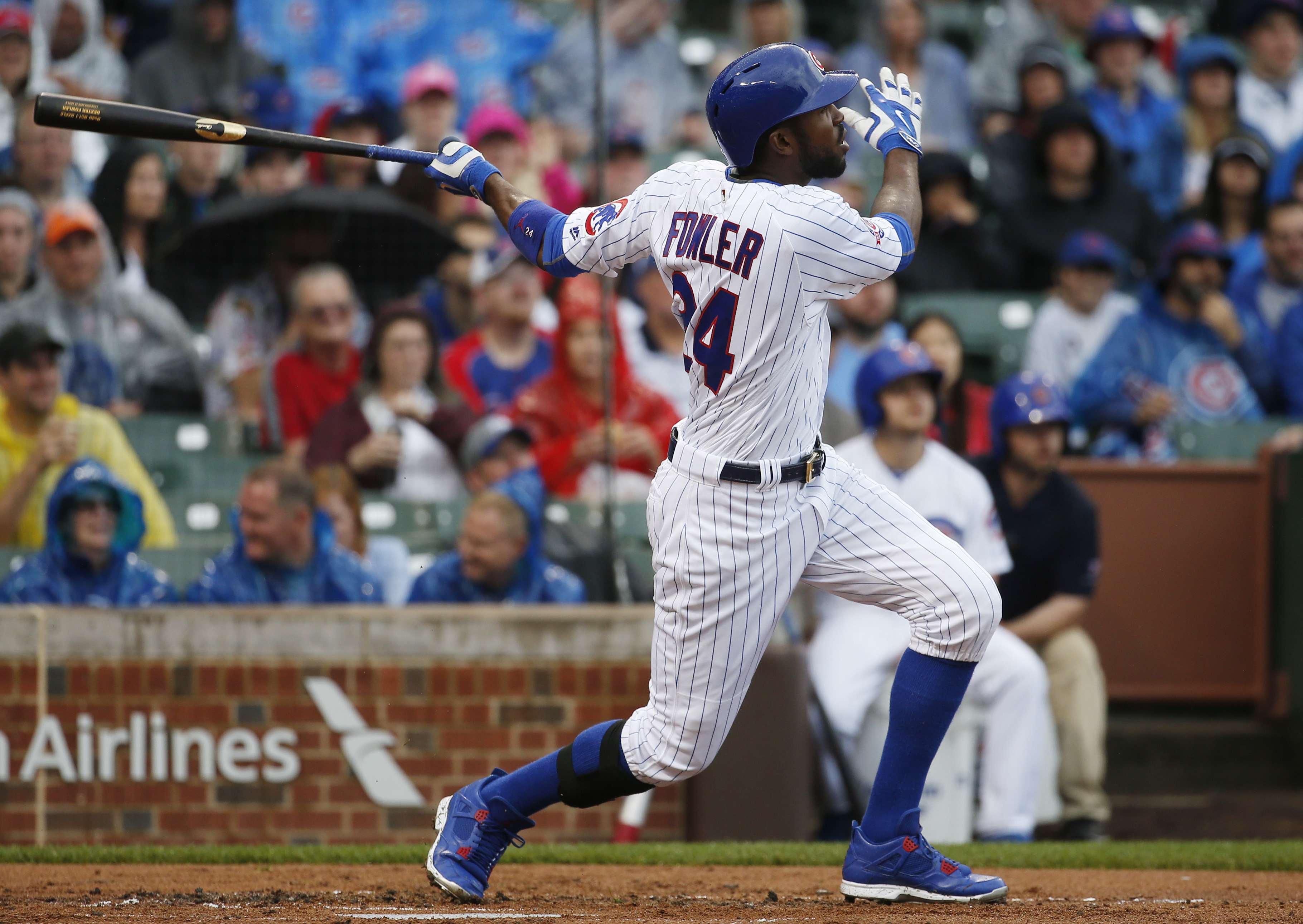 Chicago Cubs' Dexter Fowler watches after hitting a solo home run against the Arizona Diamondbacks during the first inning of a baseball game, Saturday, June 4, 2016, in Chicago. (AP Photo/Nam Y. Huh)