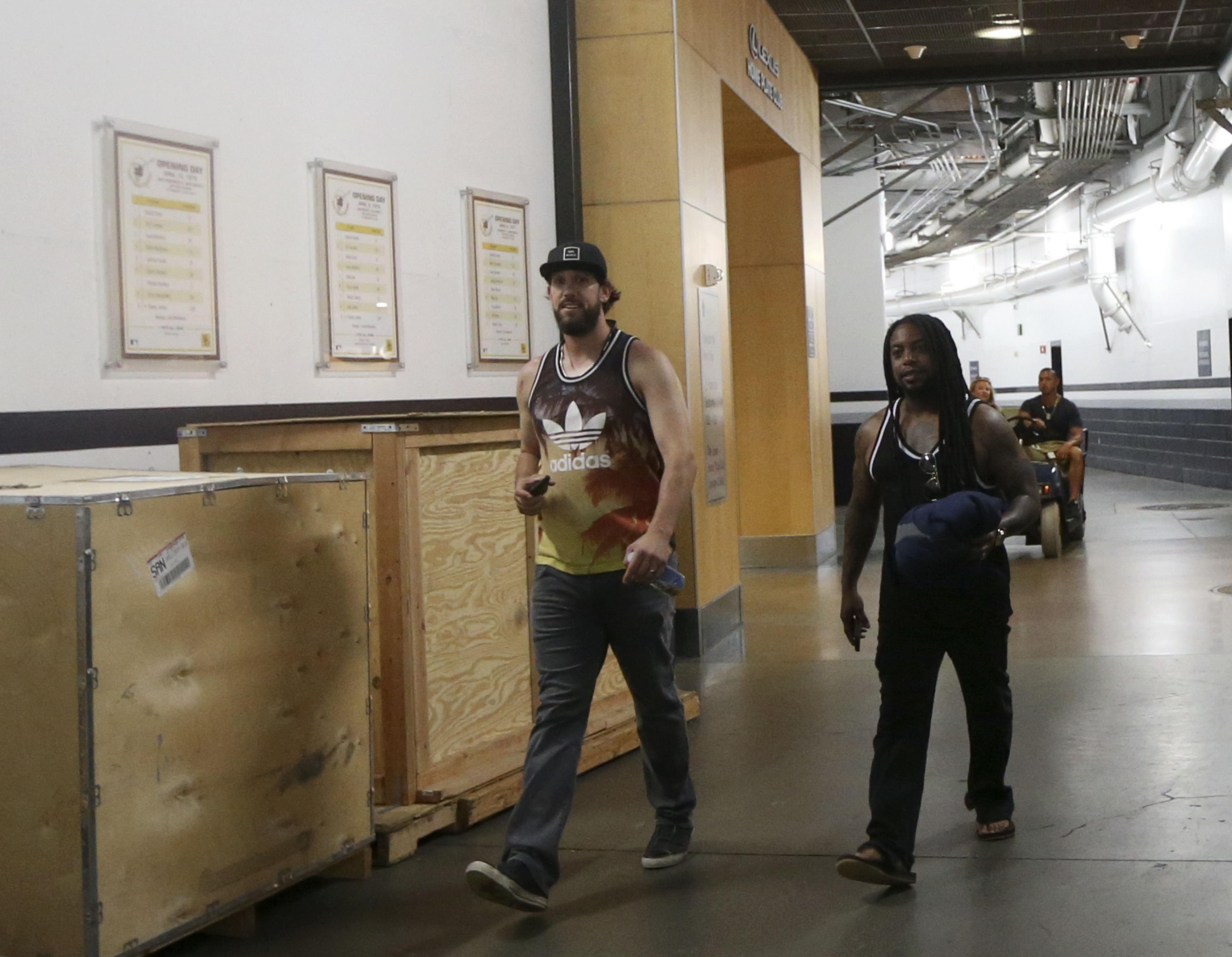 Pitcher James Shields, left, is accompanied by an unknown associate as he leaves Petco Park after being traded by the San Diego Padres to the Chicago White Sox, Saturday June 4, 2016, in San Diego. (AP Photo/Lenny Ignelzi)