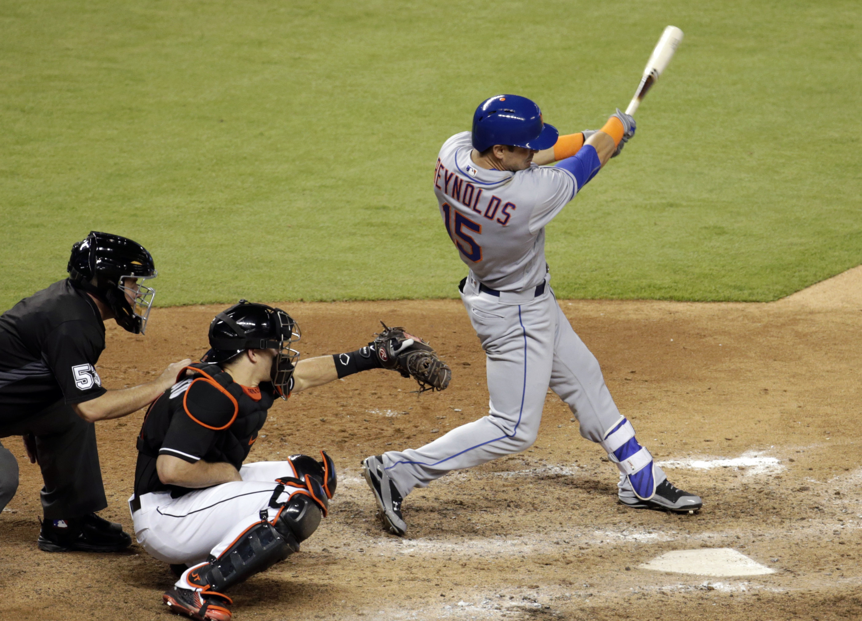 New York Mets' Matt Reynolds (15) follows through on an RBI-single to score Michael Conforto during the eighth inning of a baseball game against the Miami Marlins, Saturday, June 4, 2016, in Miami. Marlins catcher J.T. Realmuto, center, looks on. (AP Phot