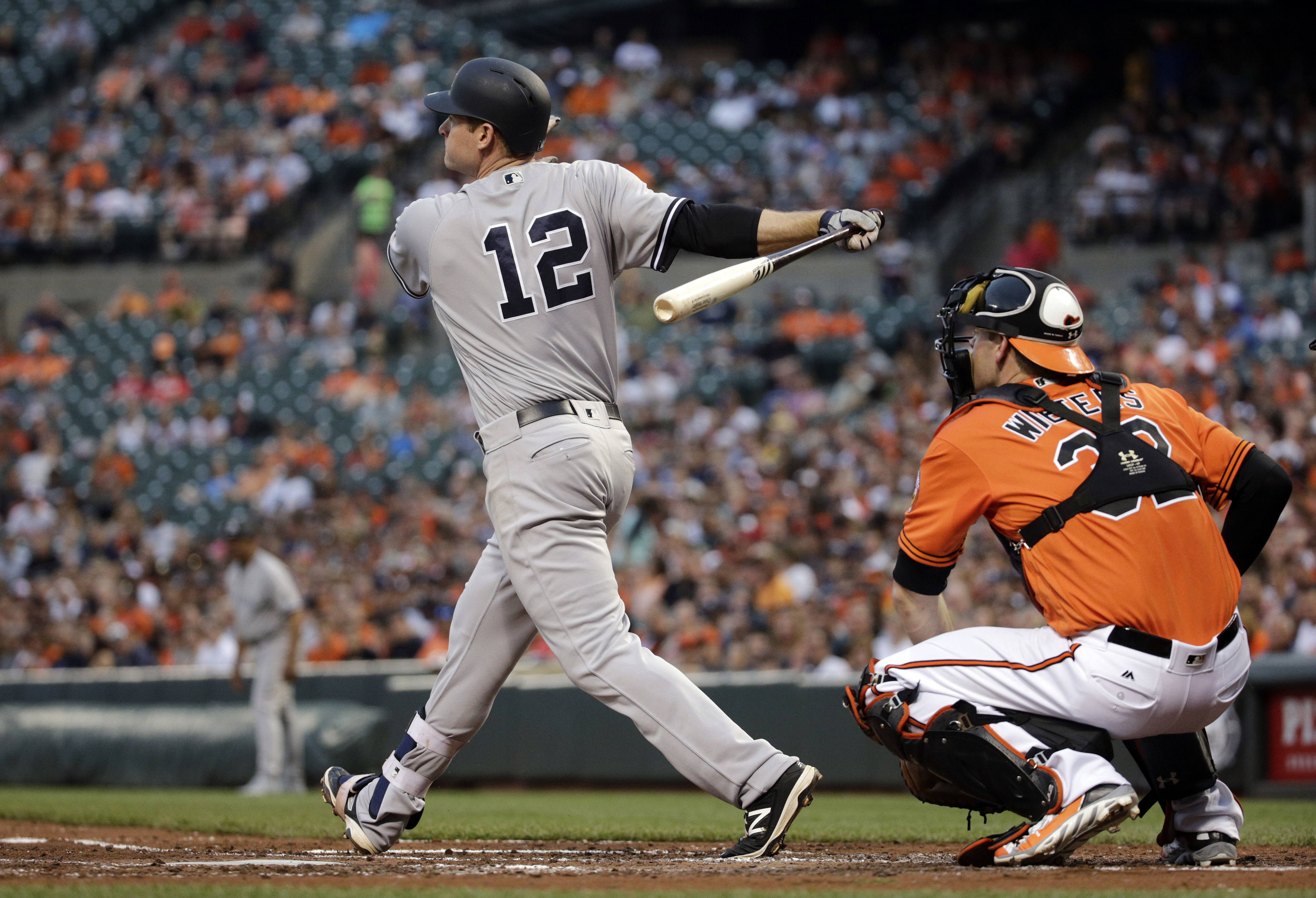 New York Yankees' Chase Headley, left, doubles in front of Baltimore Orioles catcher Matt Wieters in the third inning of a baseball game in Baltimore, Saturday, June 4, 2016. (AP Photo/Patrick Semansky)