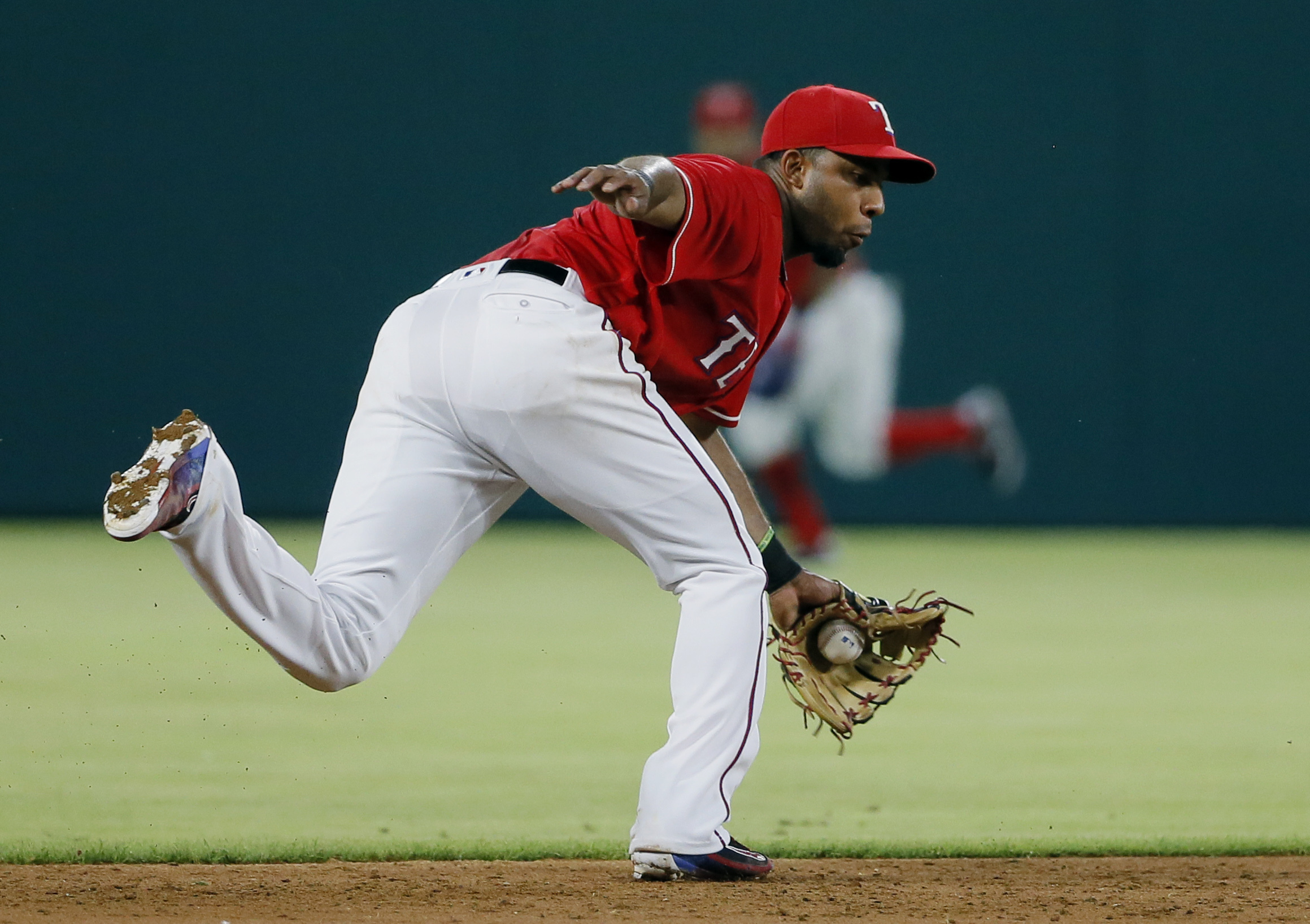 Texas Rangers shortstop Elvis Andrus reaches to his left to field a ground-out by Seattle Mariners' Franklin Gutierrez in the third inning of a baseball game on, Saturday, June 4, 2016, in Arlington, Texas. (AP Photo/Tony Gutierrez)