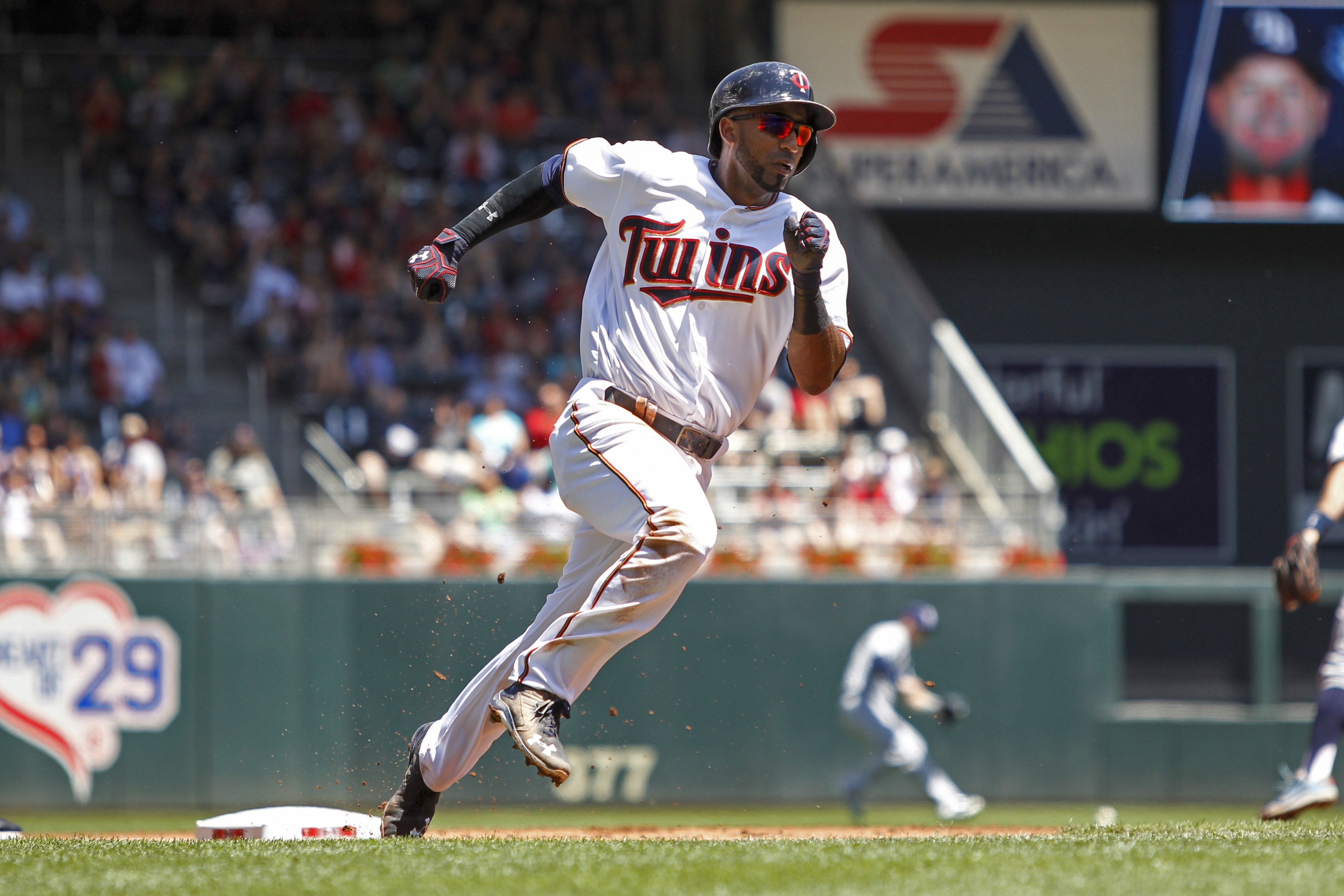 Minnesota Twins' Eduardo Nunez runs on his way to scoring from second base on a single by Joe Mauer against the Tampa Bay Rays in the first inning of a baseball game Sunday, June 5, 2016, in Minneapolis. (AP Photo/Bruce Kluckhohn)