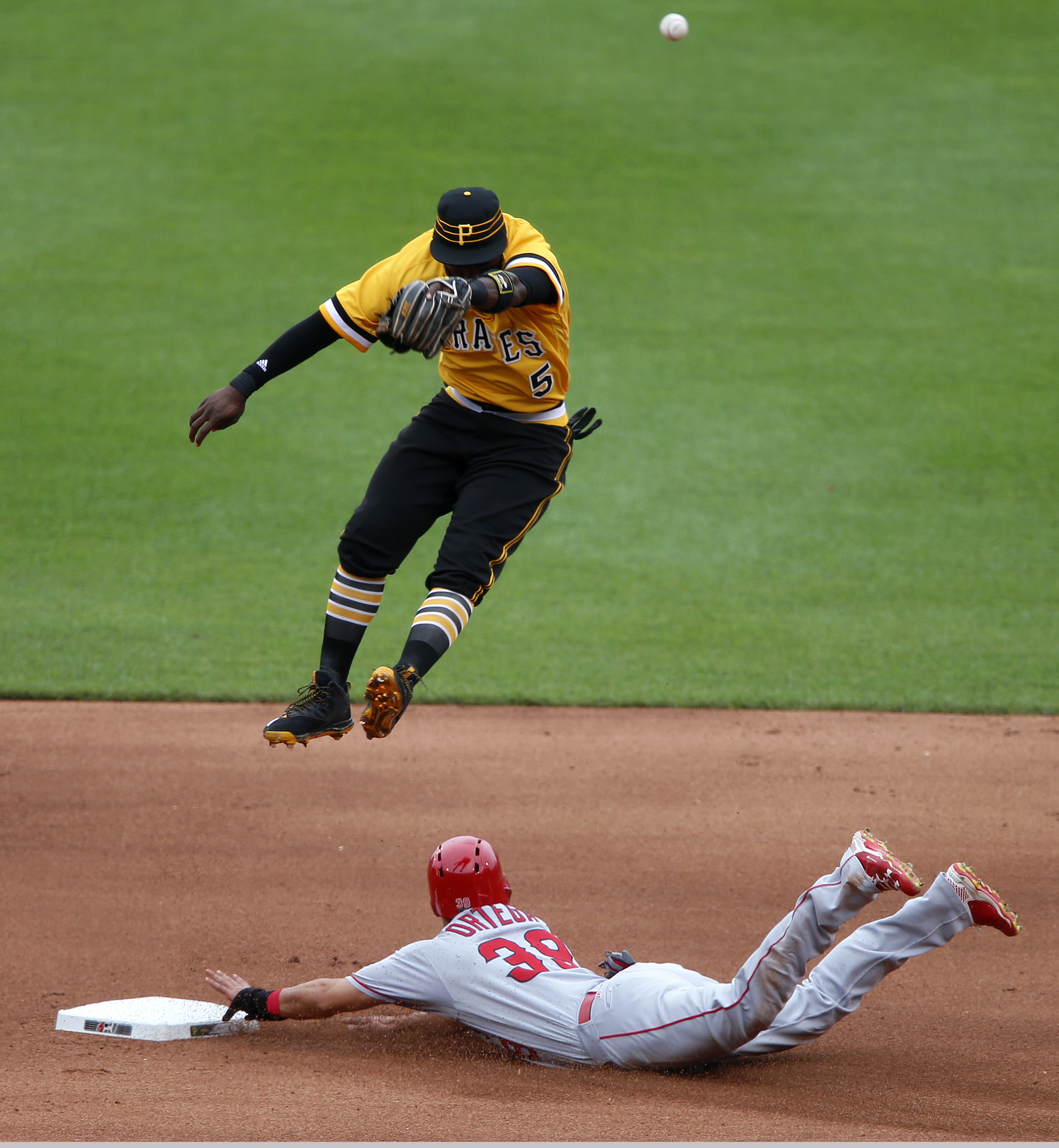 Los Angeles Angels' Rafael Ortega (39) steals second as Pittsburgh Pirates second baseman Josh Harrison (5) leaps for but cannot reach a high throw from catcher Chris Stewart during the fourth inning of a baseball game in Pittsburgh, Sunday, June 5, 2016.