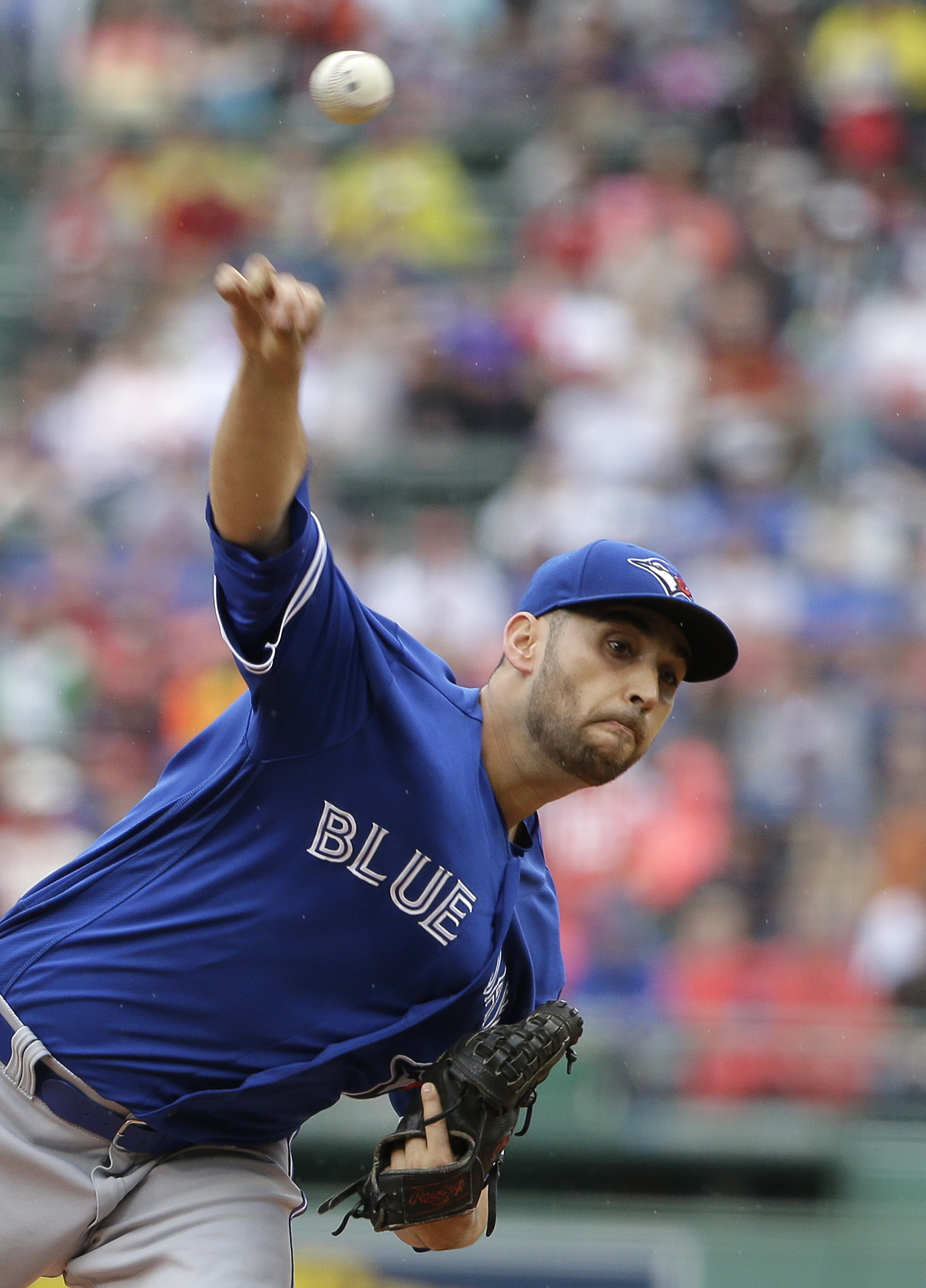Toronto Blue Jays' Marco Estrada delivers a pitch against the Boston Red Sox in the first inning of a baseball game, Sunday, June 5, 2016, in Boston. (AP Photo/Steven Senne)