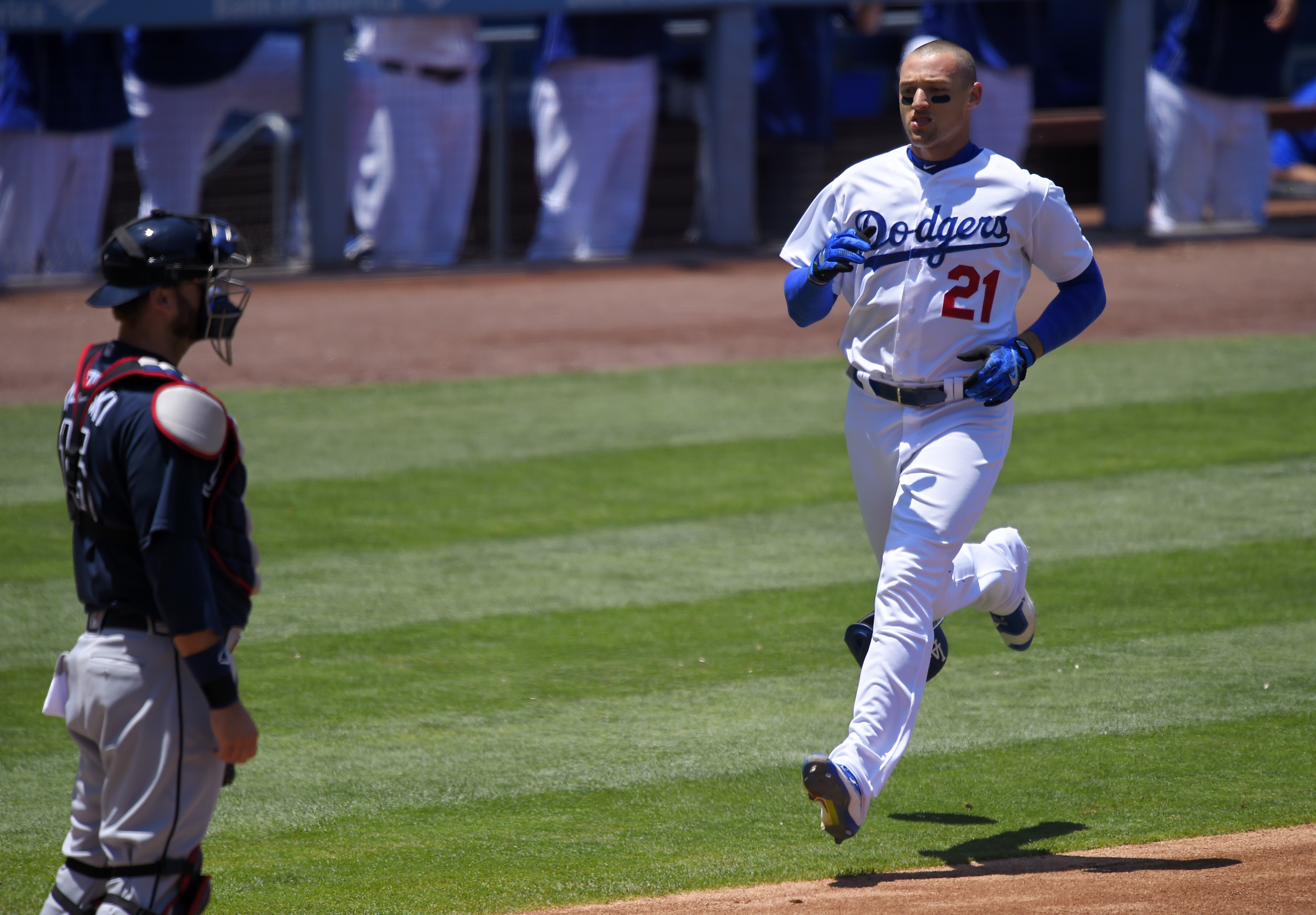 Los Angeles Dodgers' Trayce Thompson, right, heads home while Atlanta Braves catcher A.J. Pierzynski stands by as he scores on a single by Joc Pederson during the third inning of a baseball game, Sunday, June 5, 2016, in Los Angeles, Calif. (AP Photo/Mark