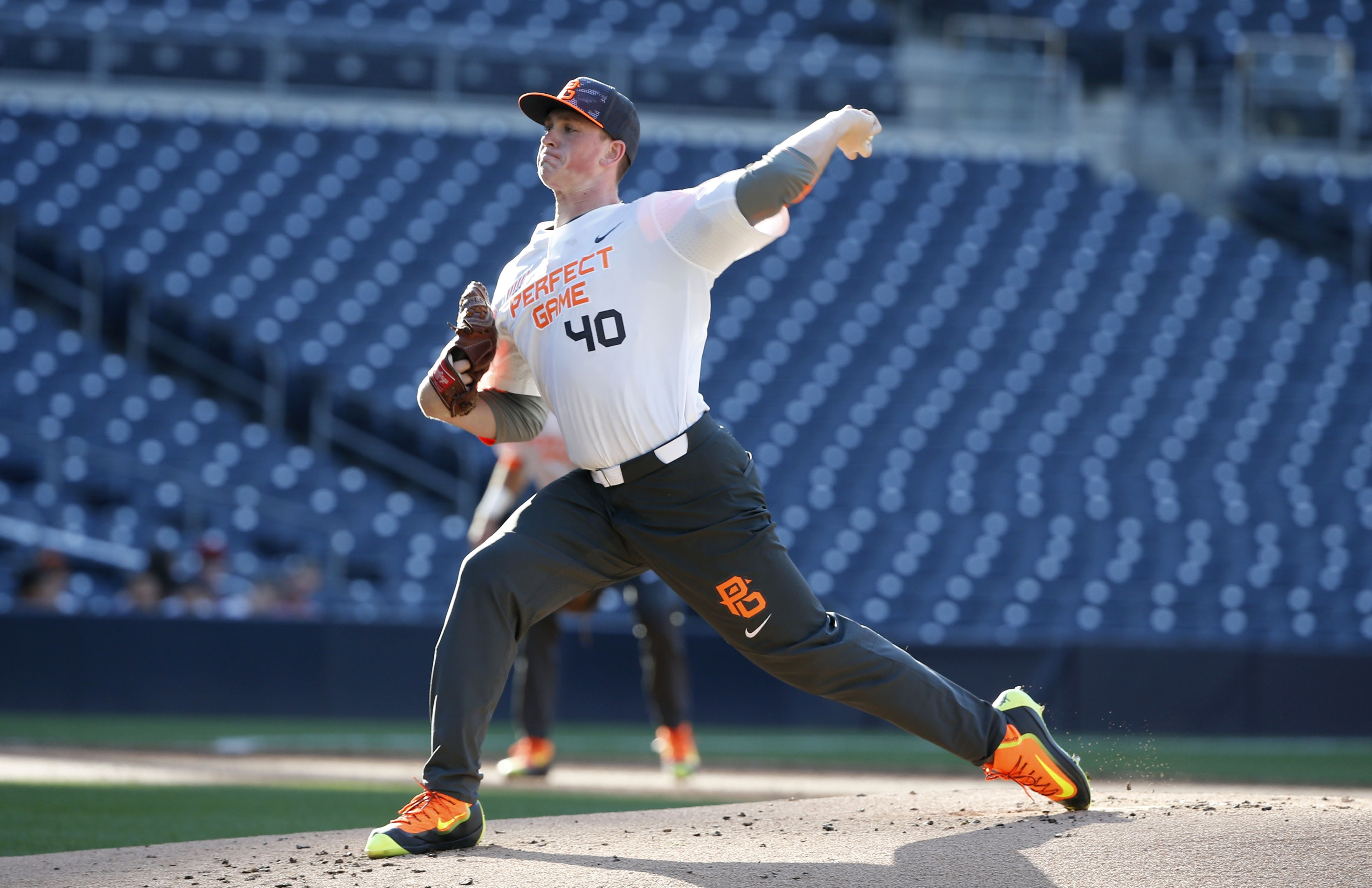 FILE - In this Aug. 16, 2015, file photo, Jason Groome pitches during the Perfect Game All-American Classic high school baseball game, in San Diego. The 17-year-old from Barnegat High School along the New Jersey Shore is 6-foot-5, 225 pounds, throws in th