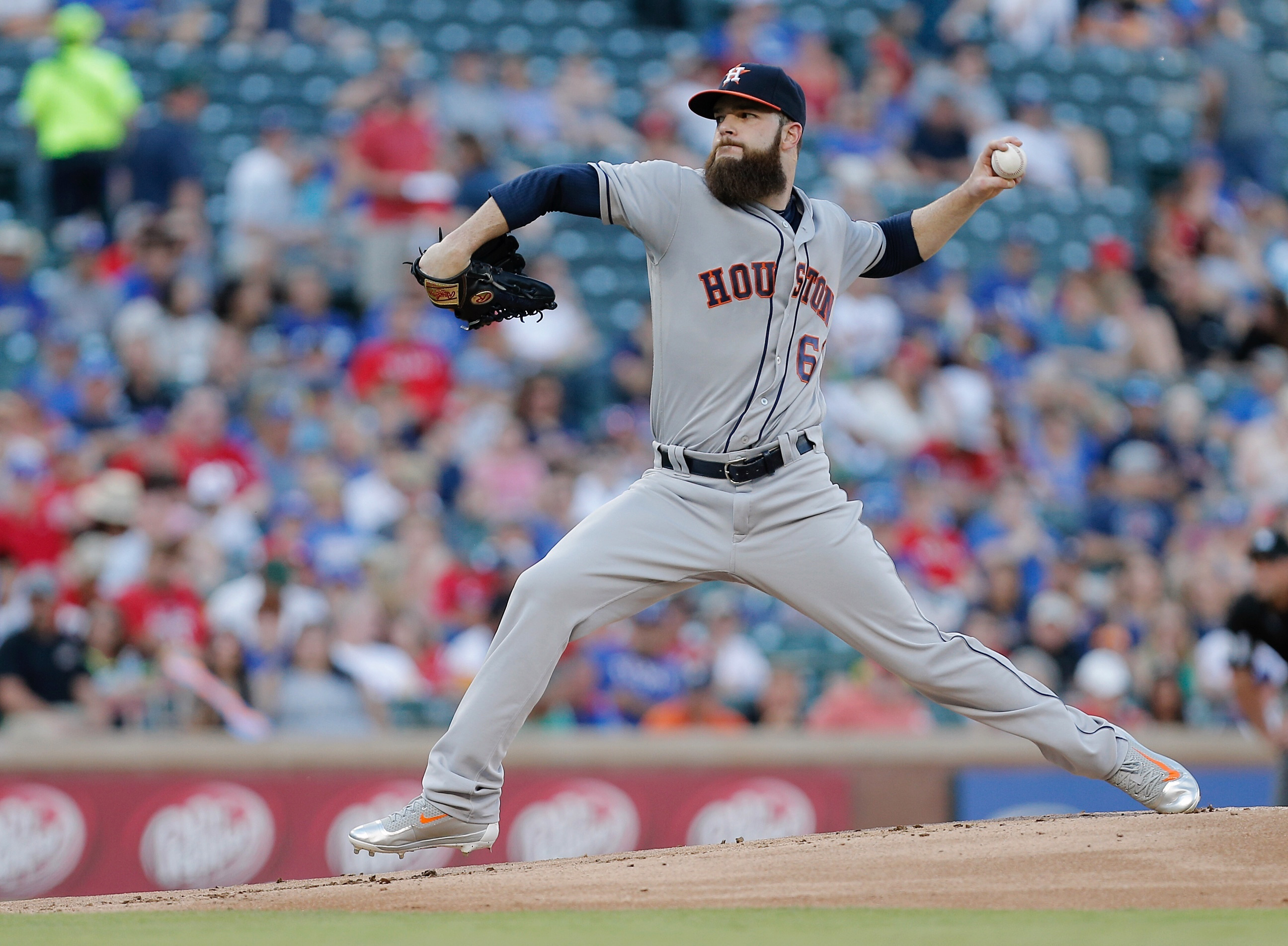Houston Astros starting pitcher Dallas Keuchel throws during the first inning of a baseball game against the Texas Rangers on Tuesday, June 7, 2016, in Arlington, Texas. (AP Photo/Brandon Wade)