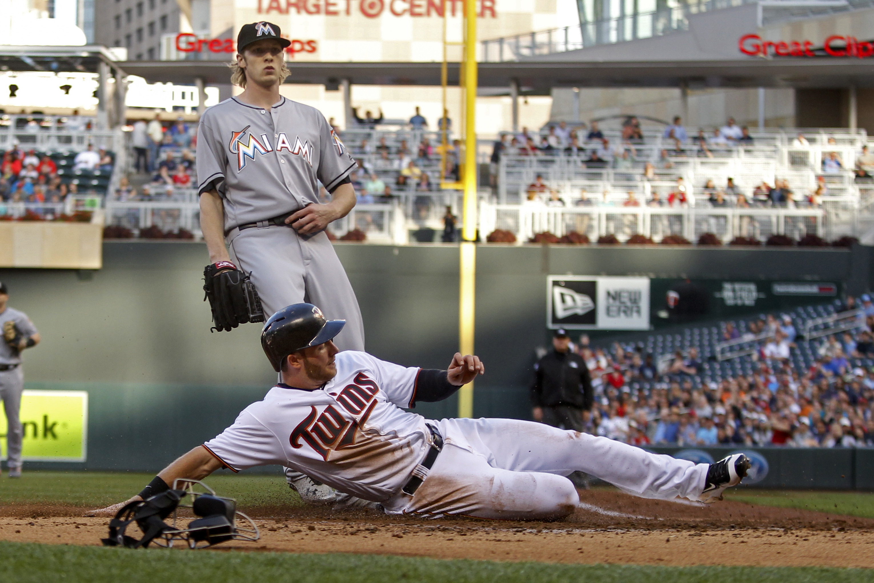 Minnesota Twins' Robbie Grossman scores on a wild pitch by Miami Marlins starting pitcher Adam Conley in the first inning of a baseball game Tuesday, June 7, 2016, in Minneapolis. (AP Photo/Bruce Kluckhohn)