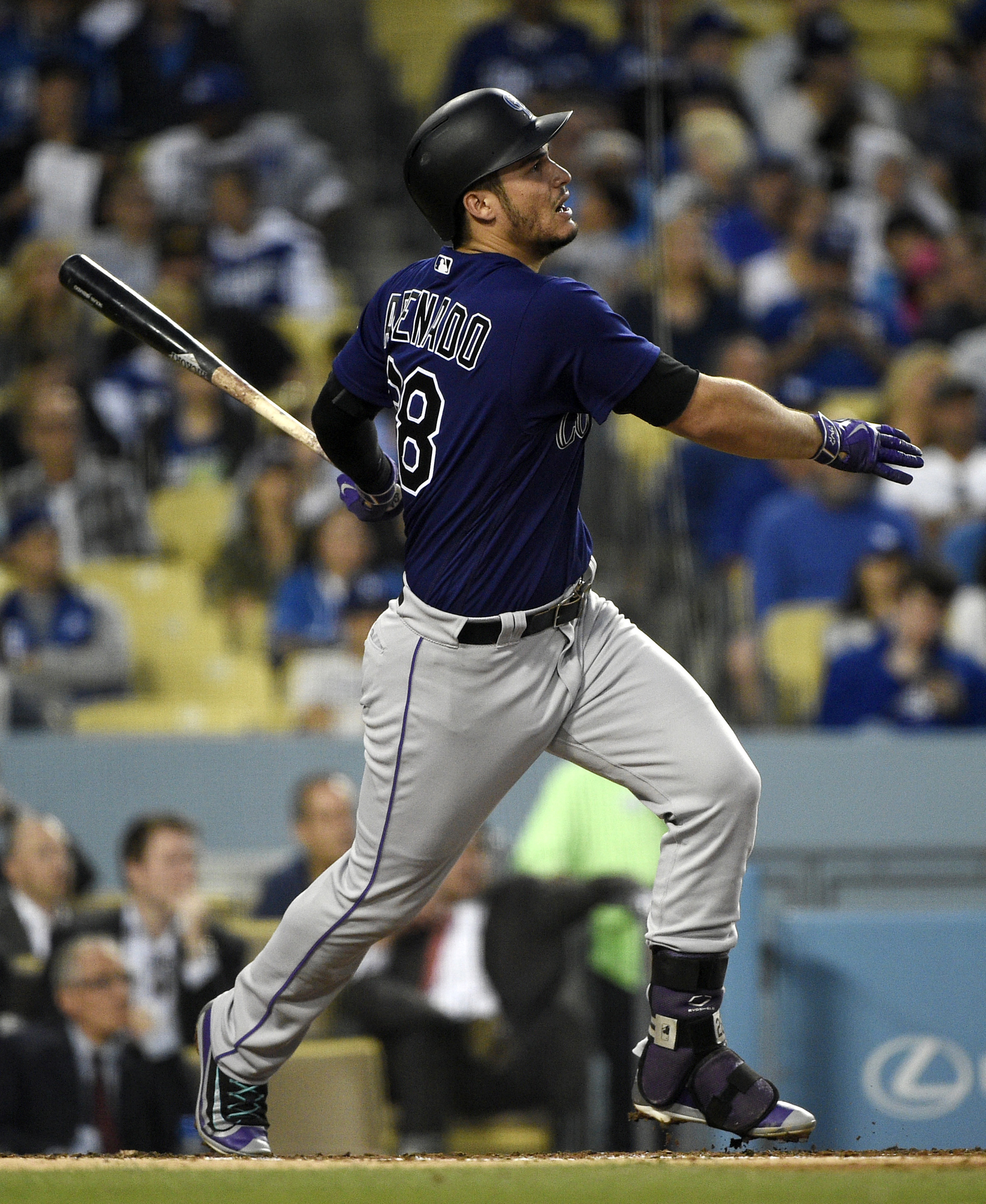 Colorado Rockies' Nolan Arenado watches his RBI double off Los Angeles Dodgers starting pitcher Julio Urias during the third inning of a baseball game in Los Angeles, Tuesday, June 7, 2016. (AP Photo/Kelvin Kuo)