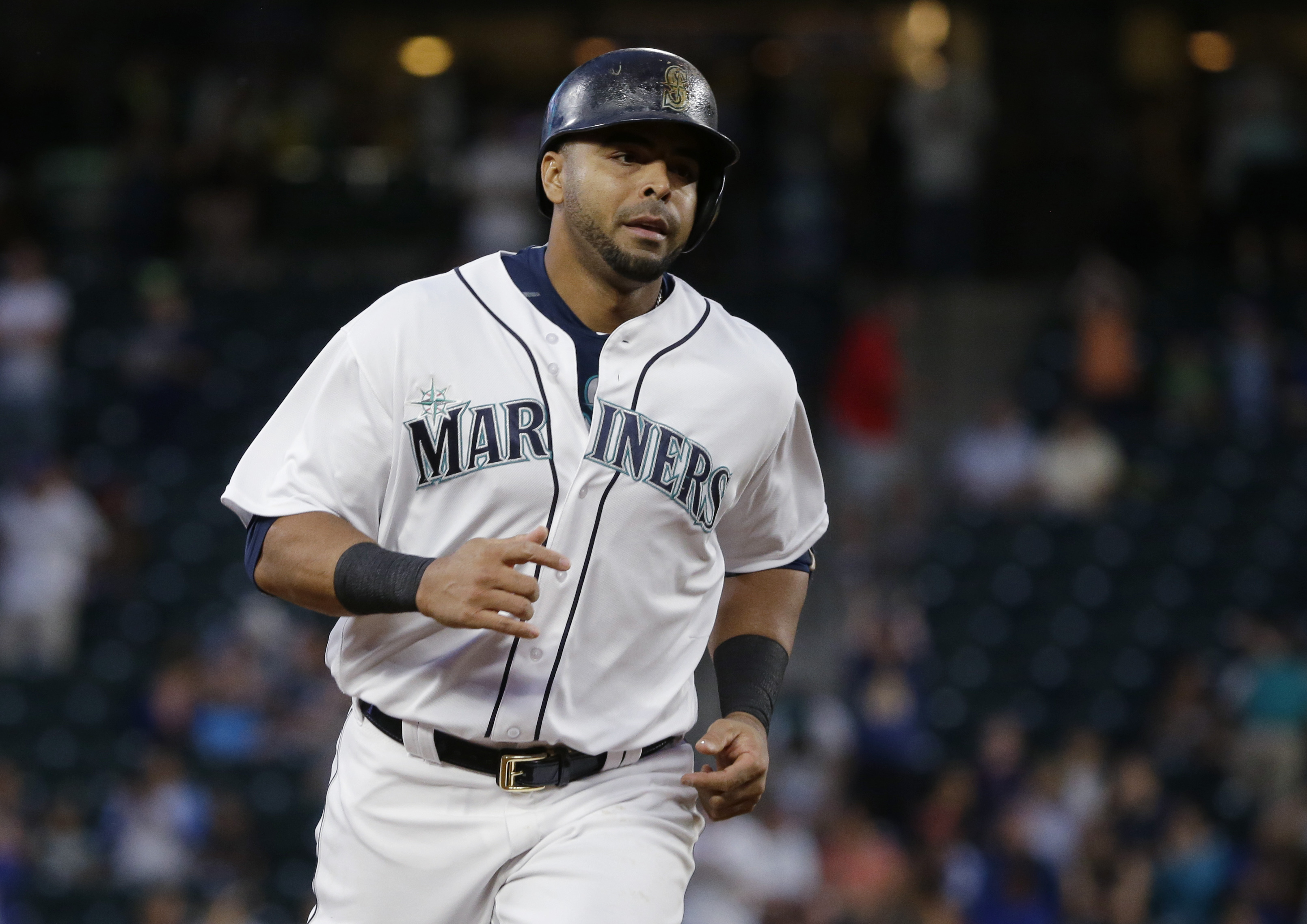 Seattle Mariners' Nelson Cruz rounds the bases after hitting a solo home run against the Cleveland Indians during the fifth inning of a baseball game, Tuesday, June 7, 2016, in Seattle. It was Cruz's second home run of the game. (AP Photo/Ted S. Warren)