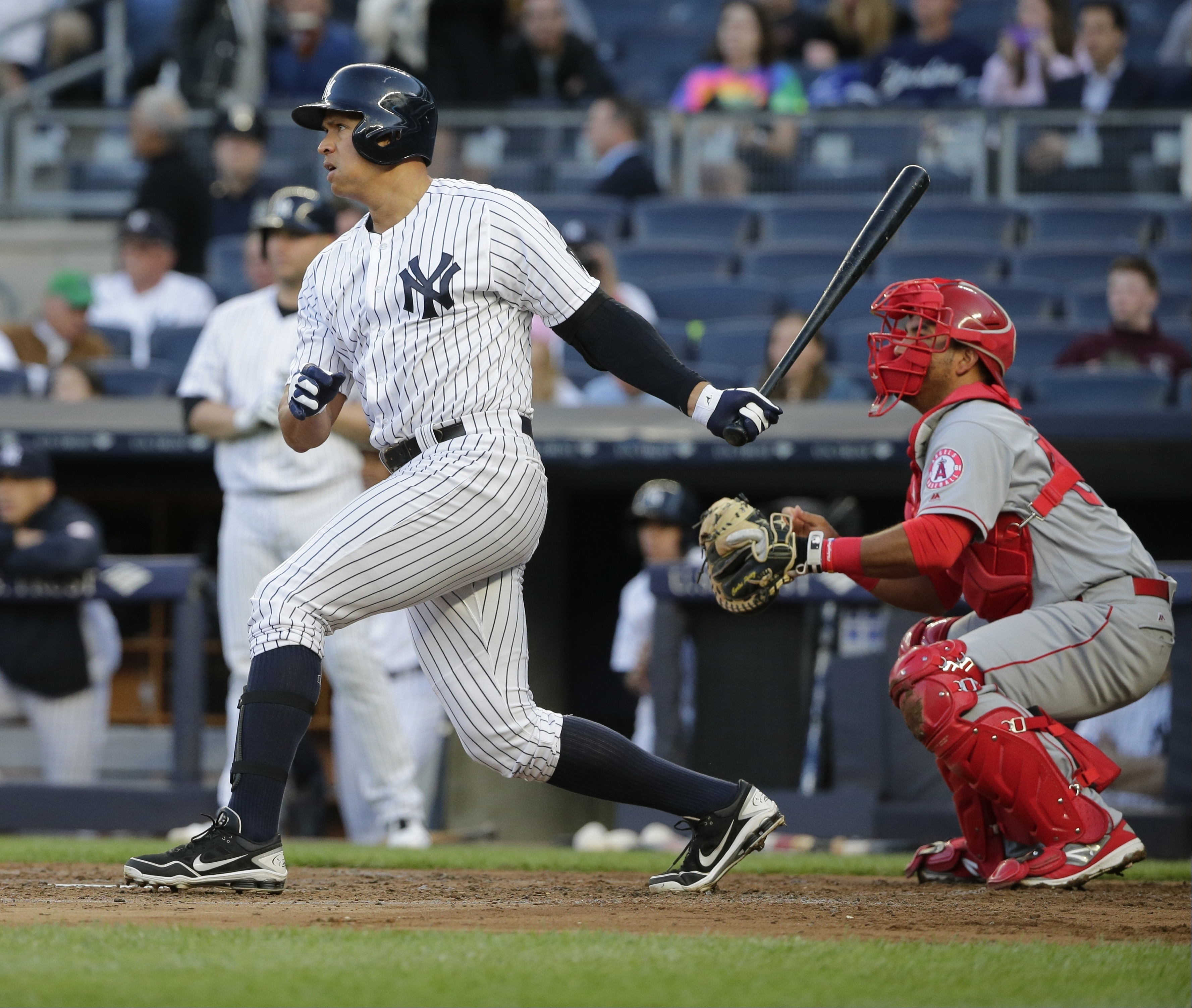 New York Yankees' Alex Rodriguez follows through on an RBI single during the first inning of a baseball game as Los Angeles Angels catcher Carlos Perez watches, Wednesday, June 8, 2016, in New York. (AP Photo/Frank Franklin II)