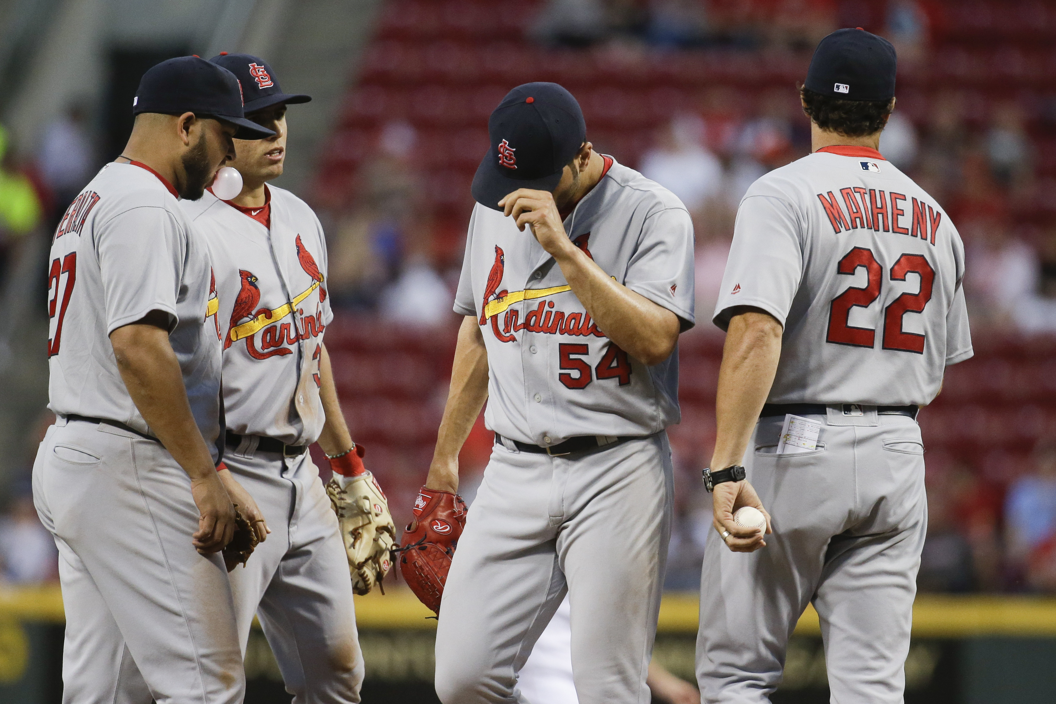 St. Louis Cardinals manager Mike Matheny (22) takes the ball from starting pitcher Jaime Garcia (54) as he is removed during the fifth inning of a baseball game, against the Cincinnati Reds on Wednesday, June 8, 2016, in Cincinnati. (AP Photo/John Minchil