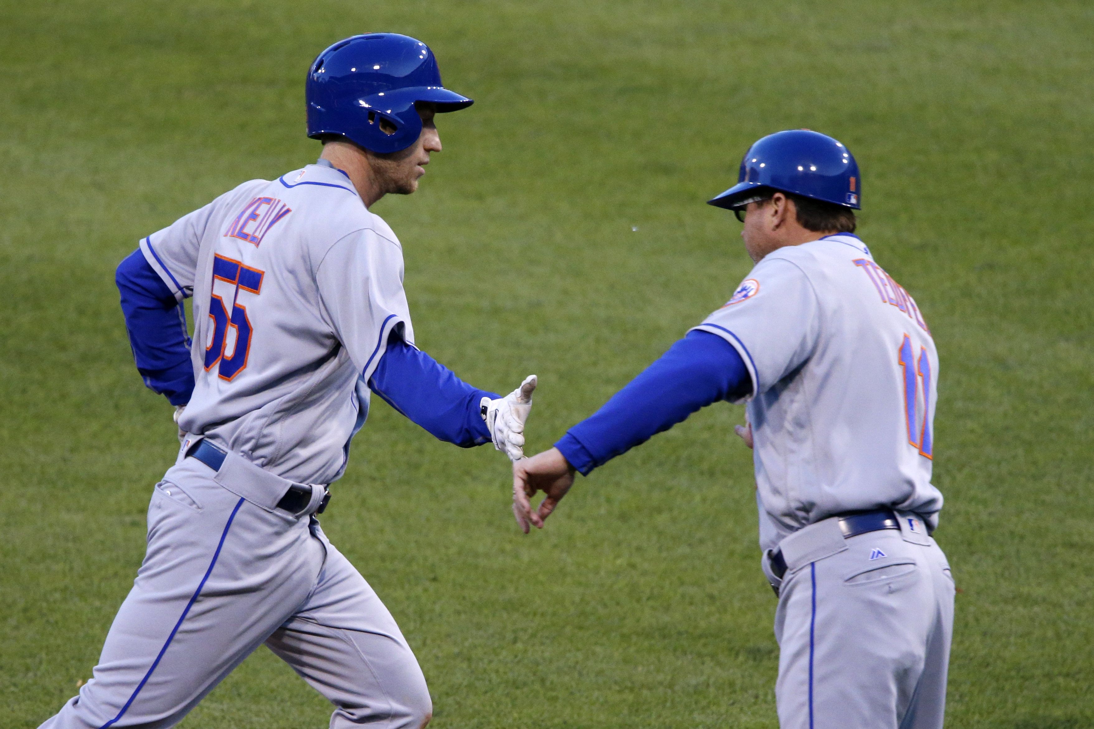 New York Mets' Ty Kelly, left, is greeted by coach Tim Teufel after hitting a two-run home run off Pittsburgh Pirates pitcher Jameson Taillon during the fourth the inning of a baseball game in Pittsburgh, Wednesday, June 8, 2016. (AP Photo/Gene J. Puskar)